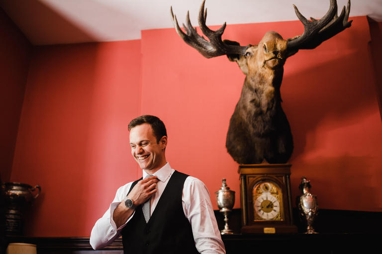 Montreal Wedding Photography Dorval Forest Stream Club Brent Calis Photography groom getting ready moose head
