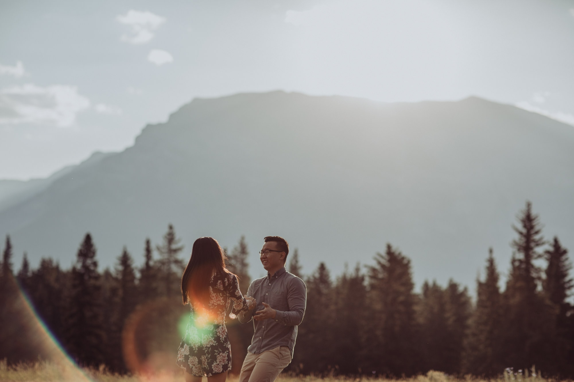 Banff Montreal Wedding Canmore Engagement Quarry Lake Montreal Traveling Destination Photographer Brent Calis Field Mountains Back Light Flare