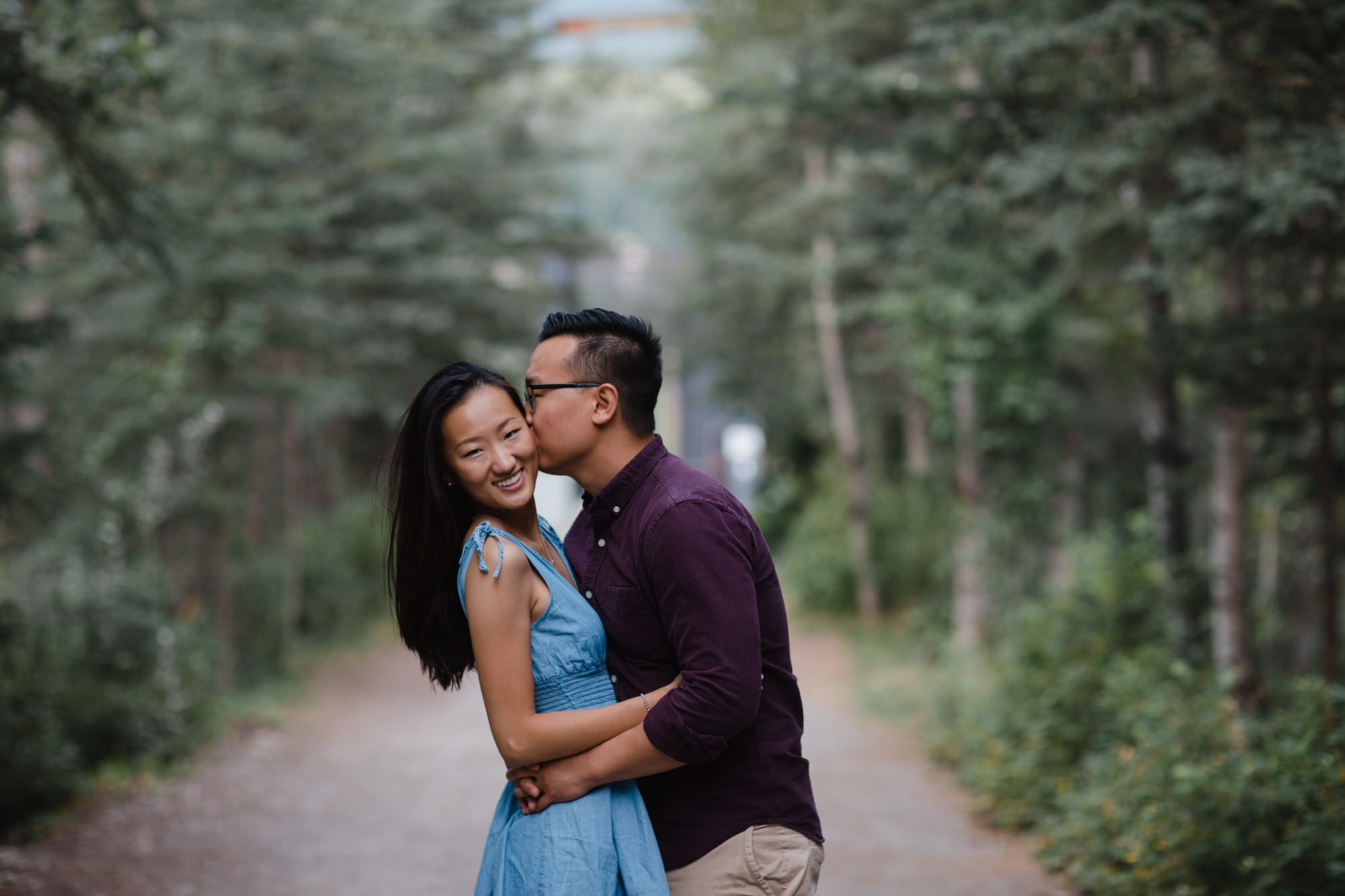 Canmore Engagement Couple Forest Bridge Banff Montreal Wedding