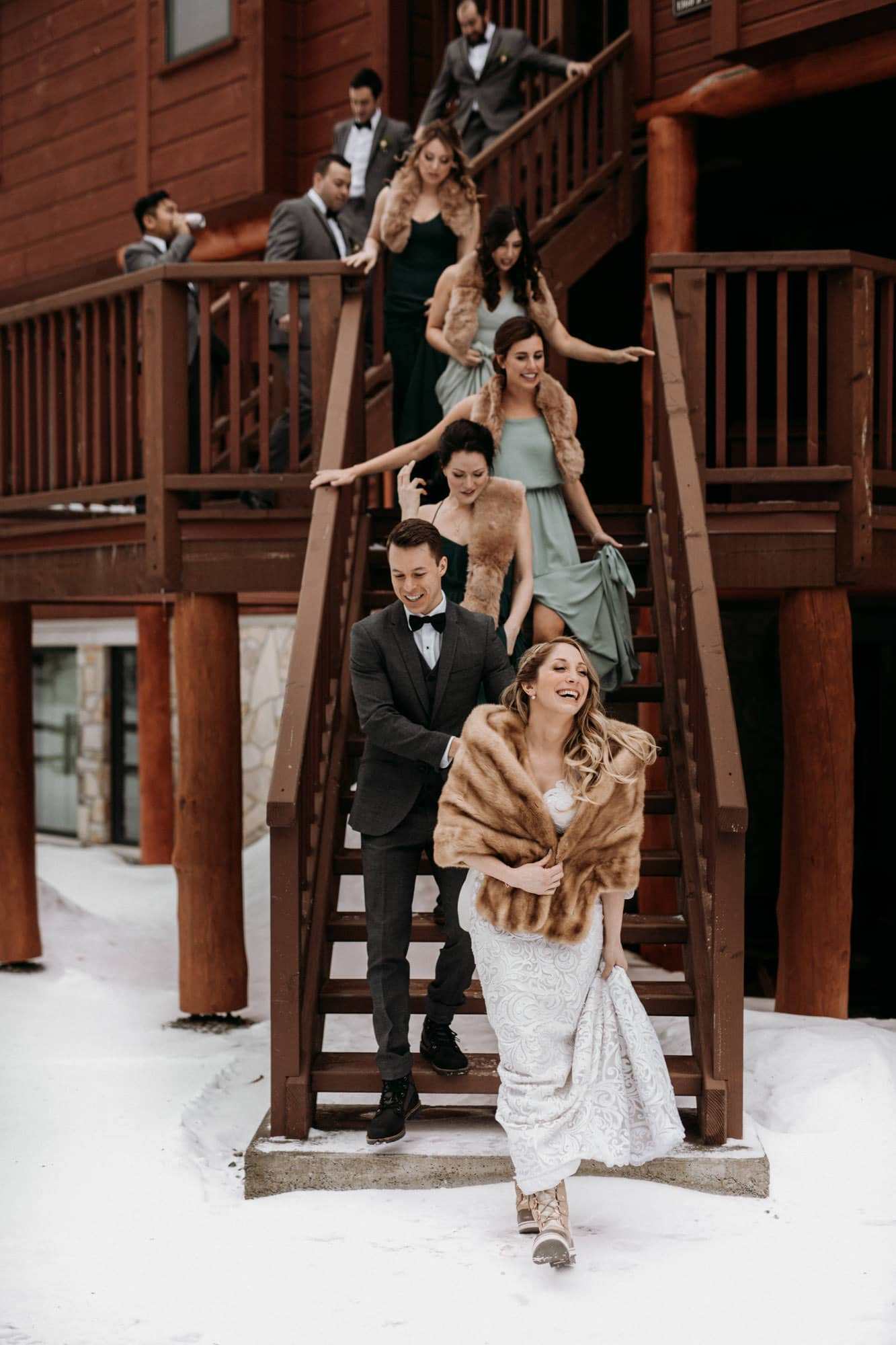 bridal party stairs wooded cabin winter wedding