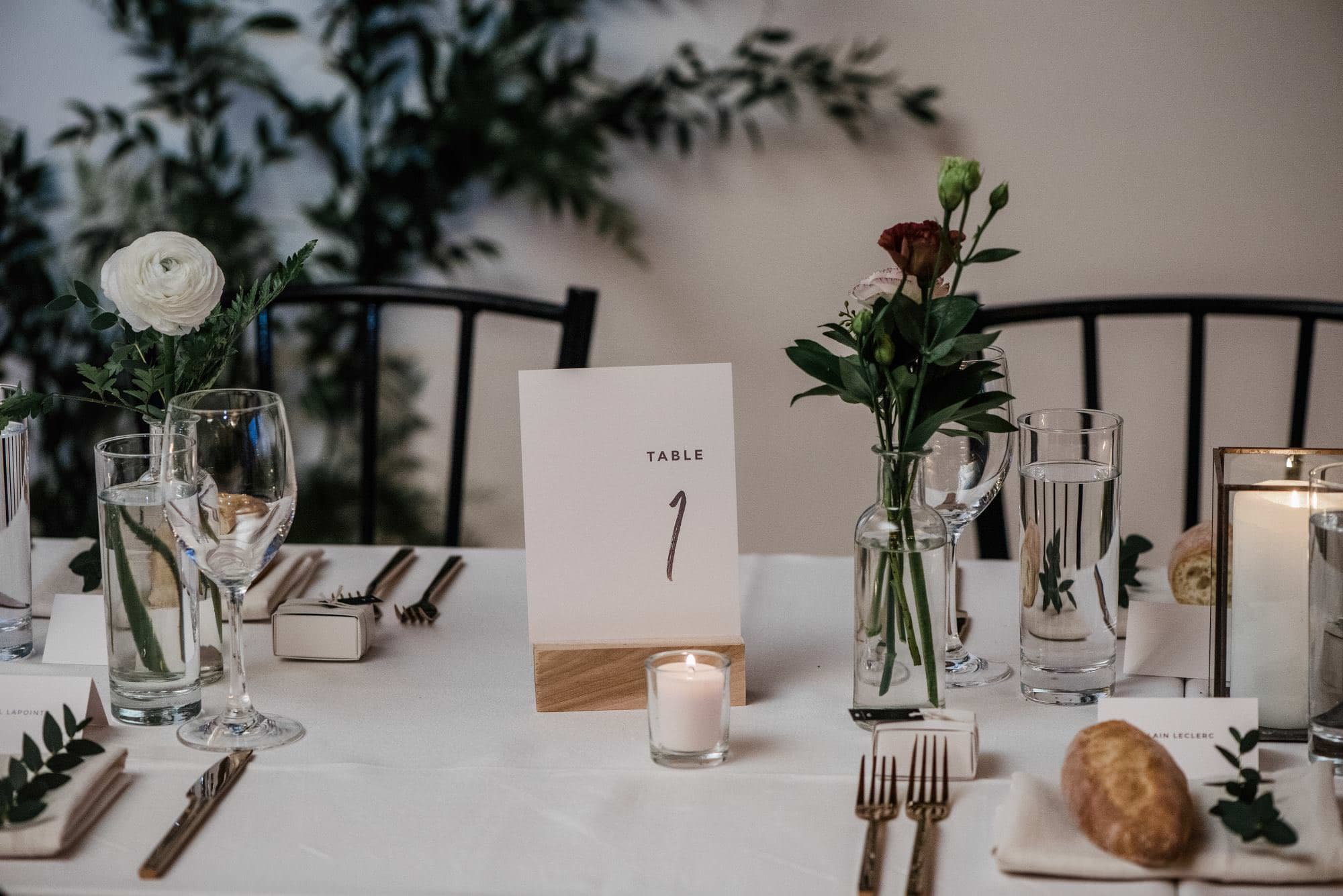 Table details at a wedding in St Henri Montreal at Parisian Luandry