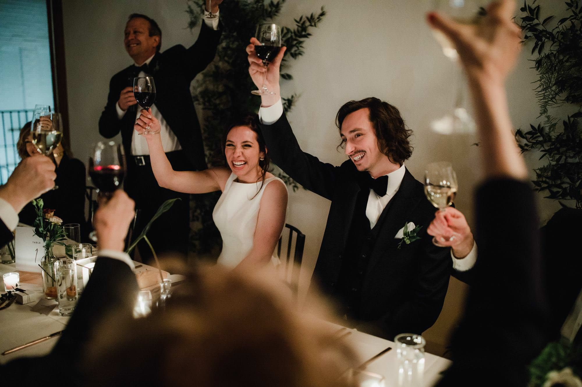 Bride and Groom Cheers at head table