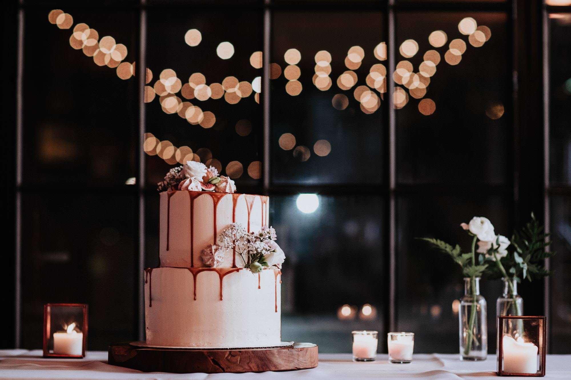 Cake by Gateu Bourgeoys Bokeh String Bulb Lights in background