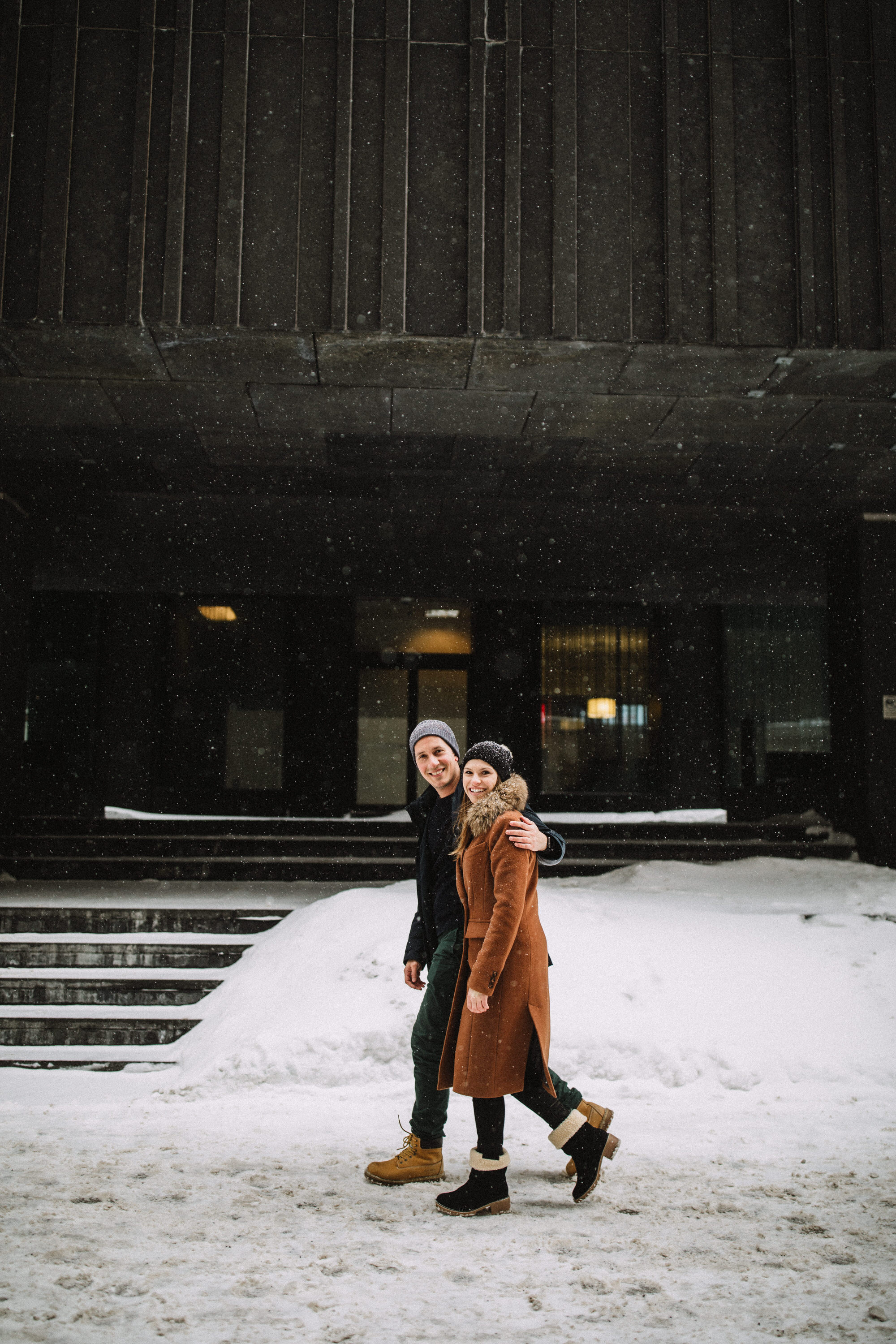 A stroll though vieux port Montreal during their winter engagement session with Montreal photographer Brent Calis.