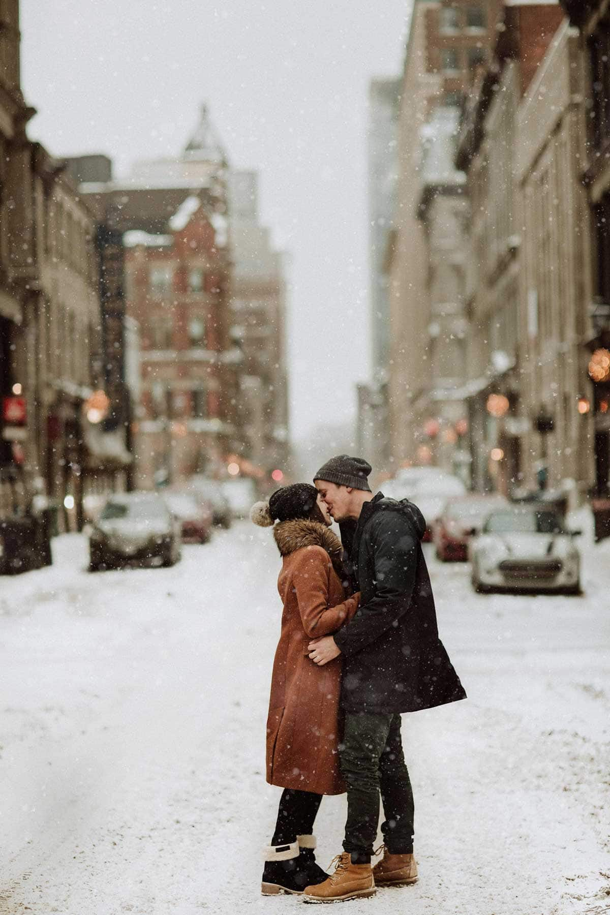 The street kiss. Urban engagement session in snowy old port Montreal with photographer Brent Calis.