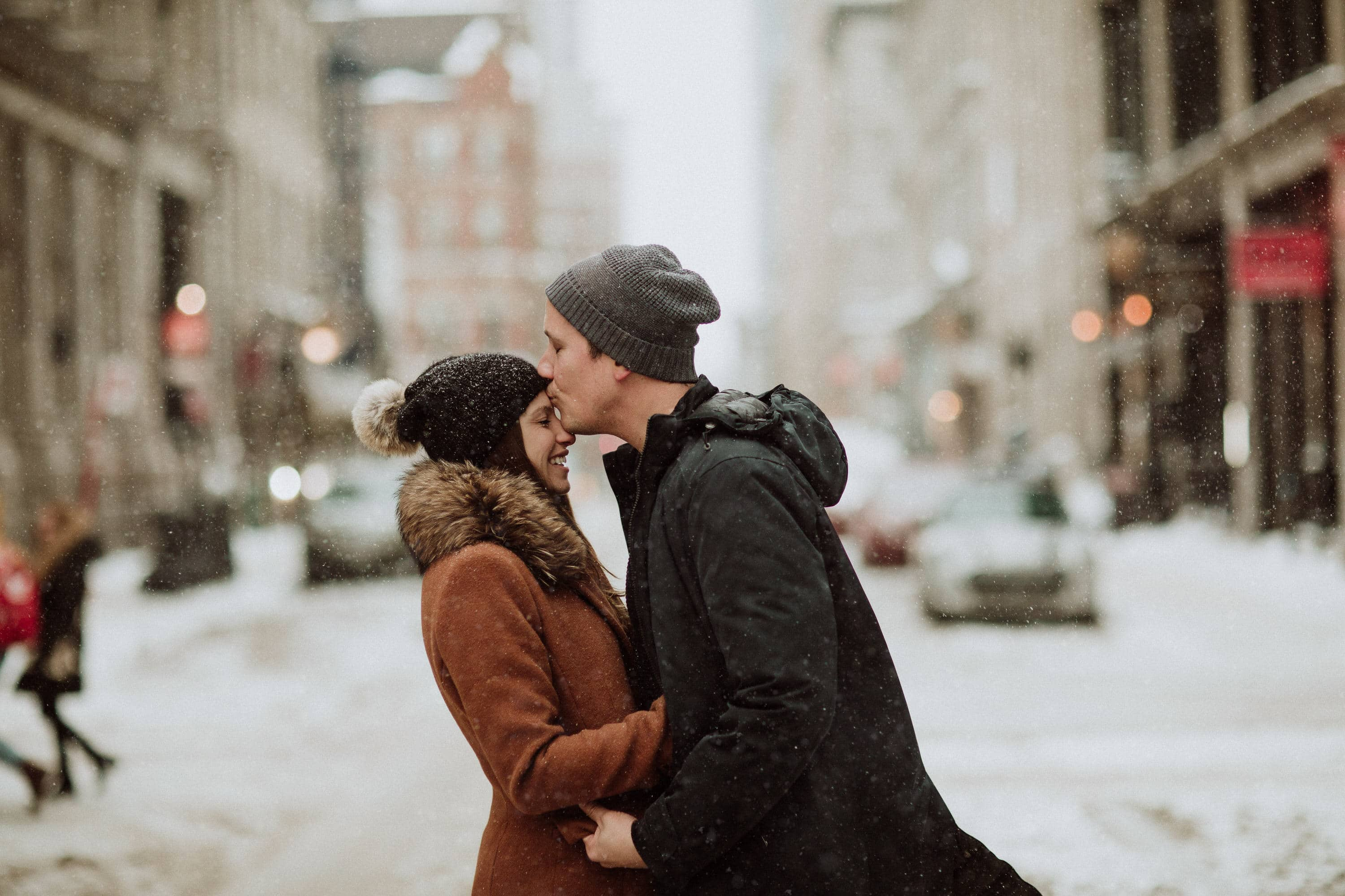 Forehead kisses during this urban engagement session in old port Montreal with photographer Brent Calis.