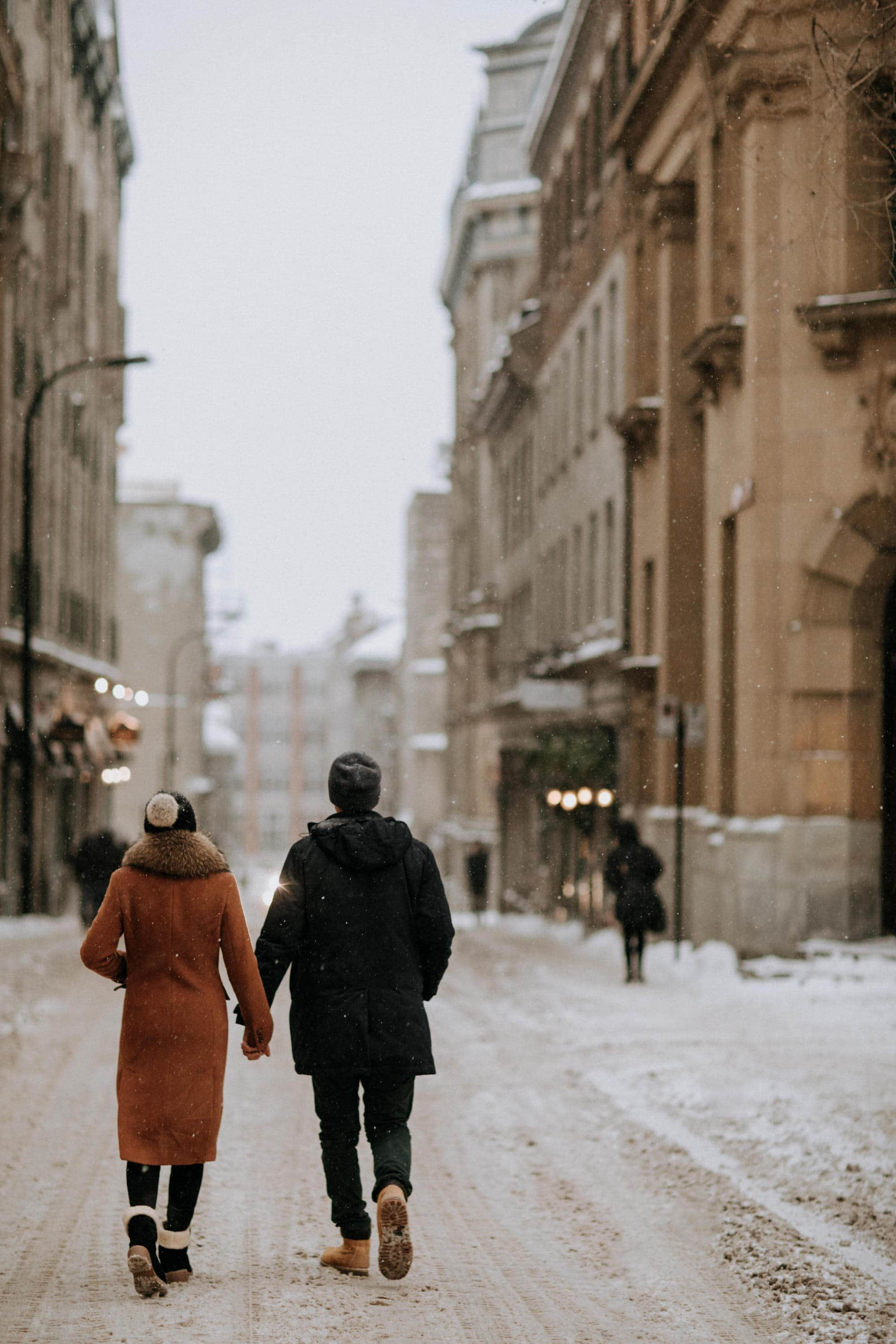 Snowy winter engagement session in old port Montreal with photographer Brent Calis.