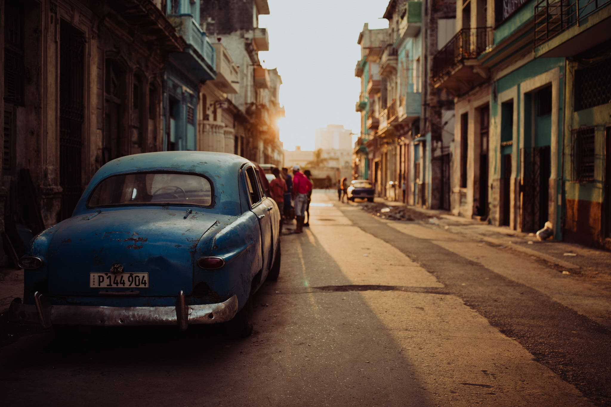 Classic cars at sunset in Centro Havana. Travel photographer Brent Calis.