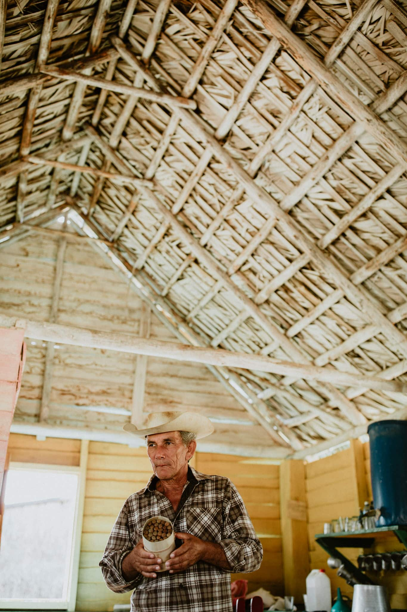Tobacco farmer with fresh cigars in Vinales, Cuba. Wedding and travel photographer Brent Calis.