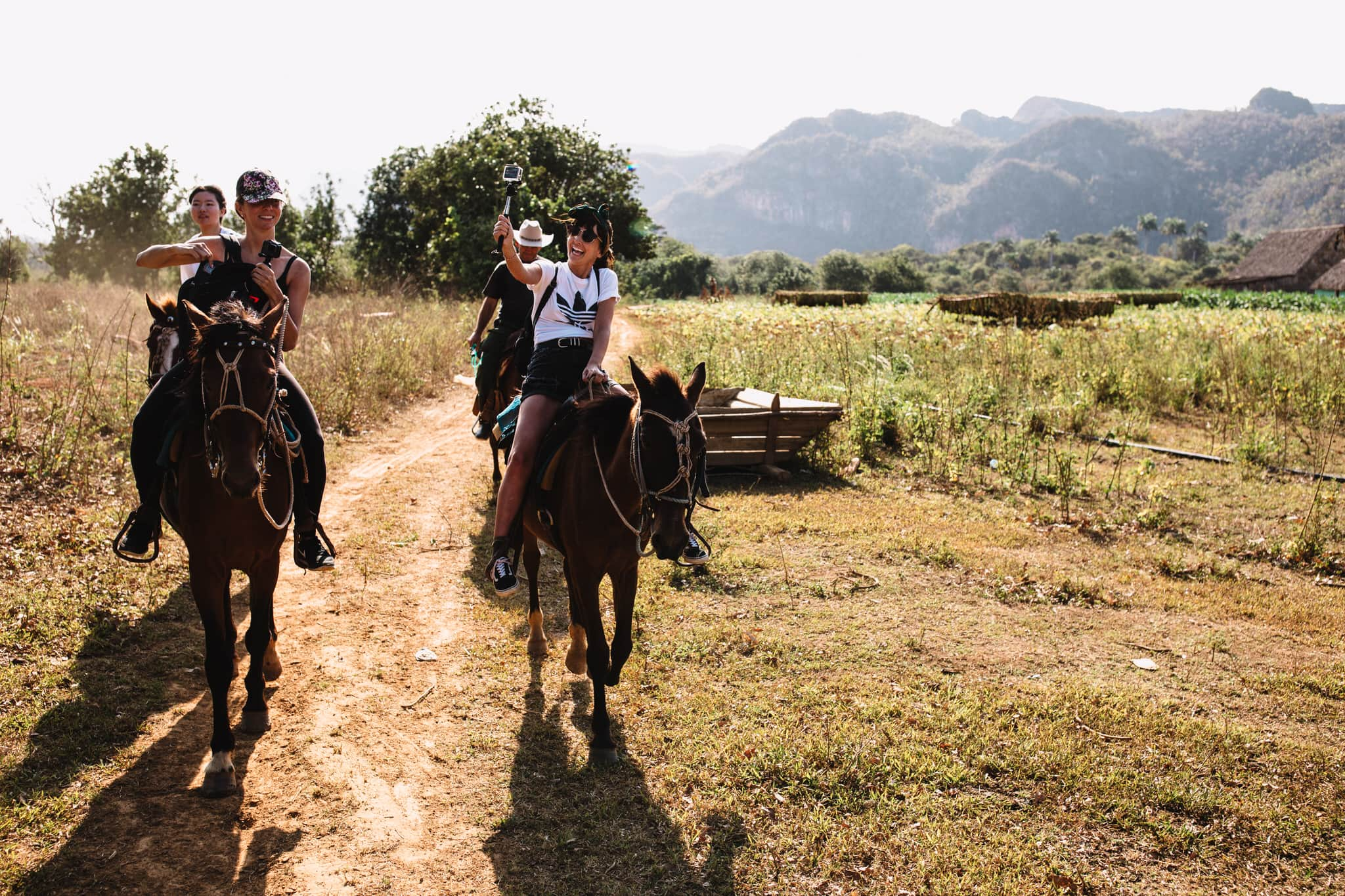Horseback tour of the cigar farm in Vinales, Cuba. Wedding and travel photographer Brent Calis.