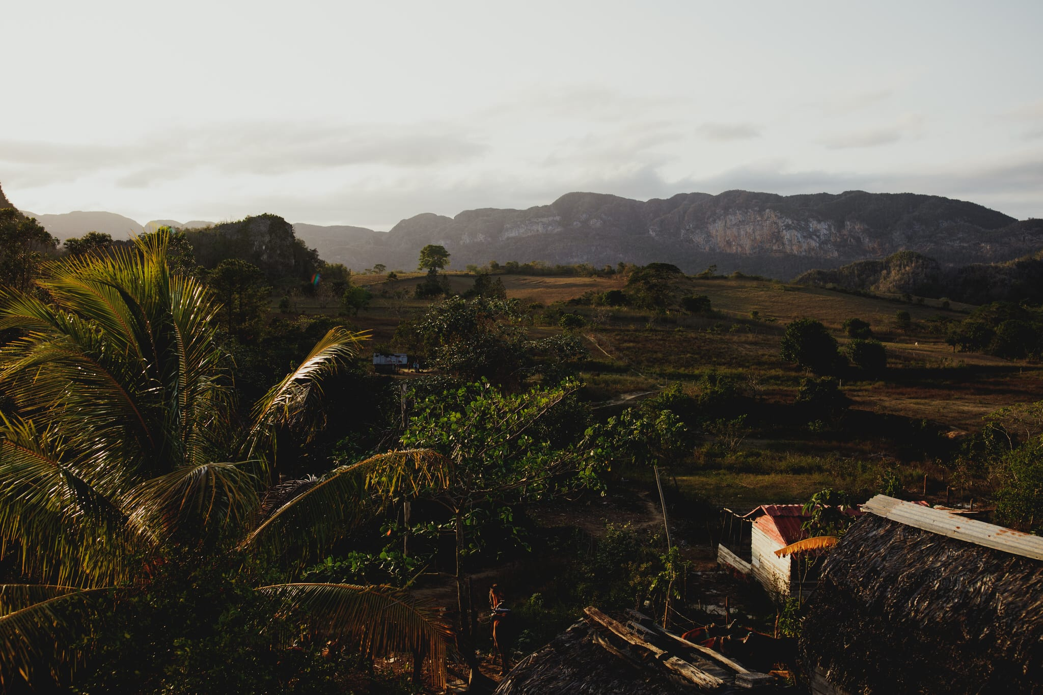 Tobacco farm at sunset in Vinales, Cuba. Wedding and travel photographer Brent Calis.