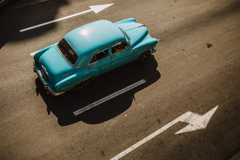 A blue Chevrolet, one of the classic cars of cuba, near the Malecon in Havana. Travel photographer Brent Calis.