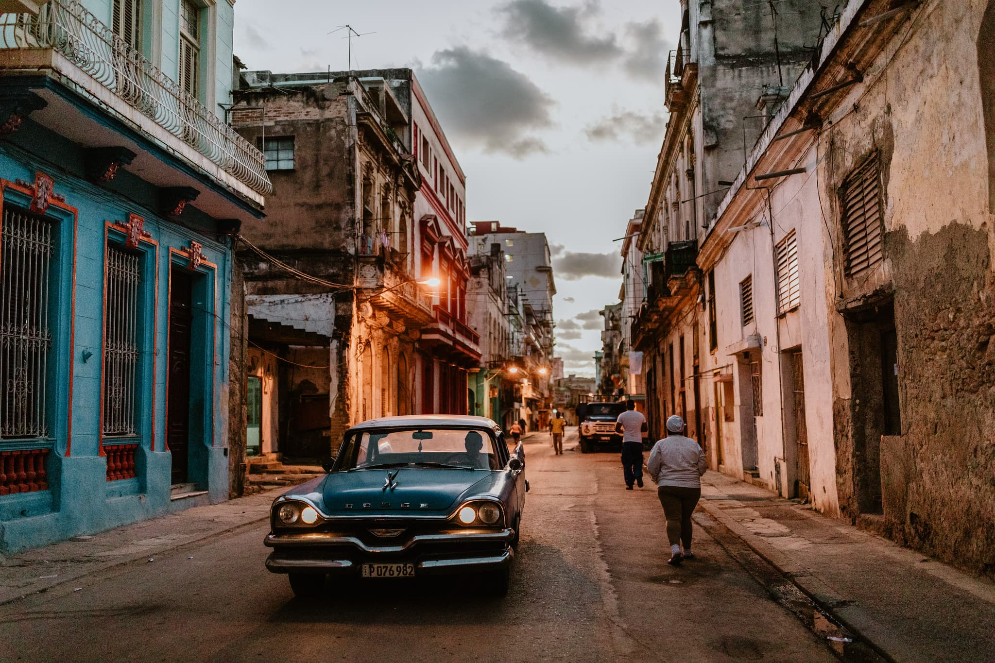 A blue Dodge at dusk in Havana, one of the classic cars of cuba. Travel photographer Brent Calis.