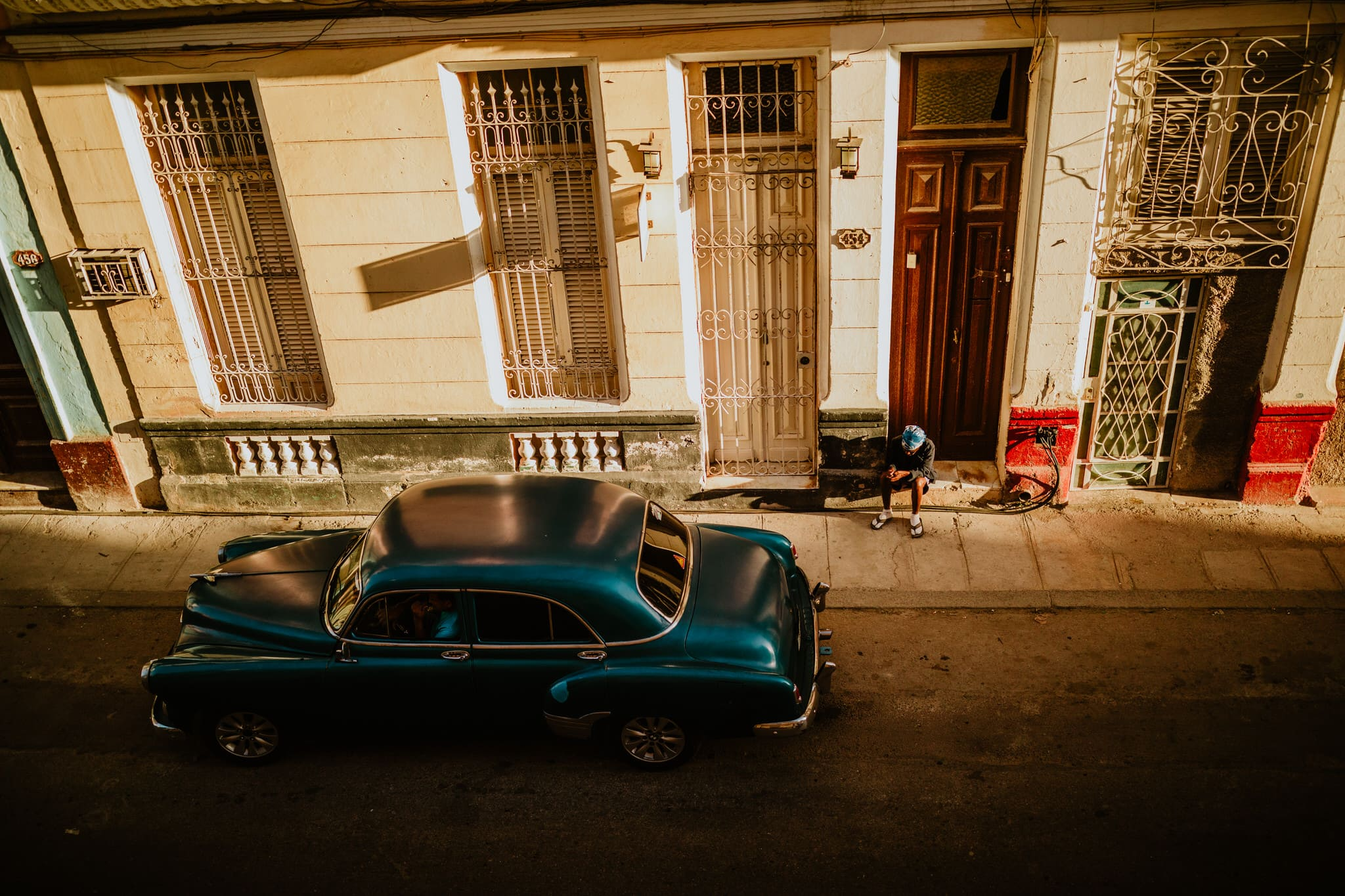 A classic teal Chevrolet at sunset, one of the classic cars of cuba, near the Malecon in Havana. Travel photographer Brent Calis.