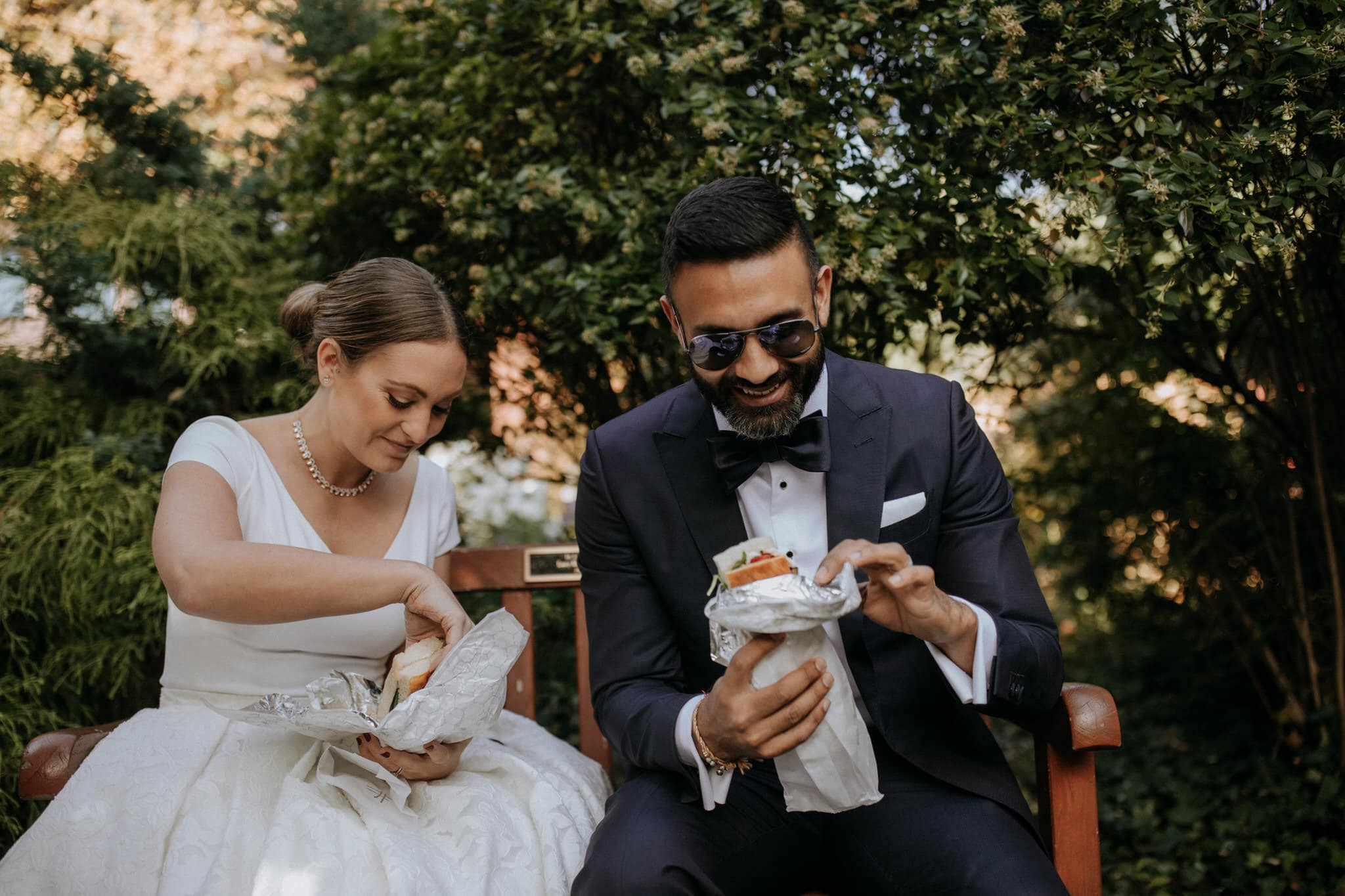 The bride and groom enjoy sandwiches from New York city's Sanpanino Sandwich Shop. Wedding Photographer Brent Calis.