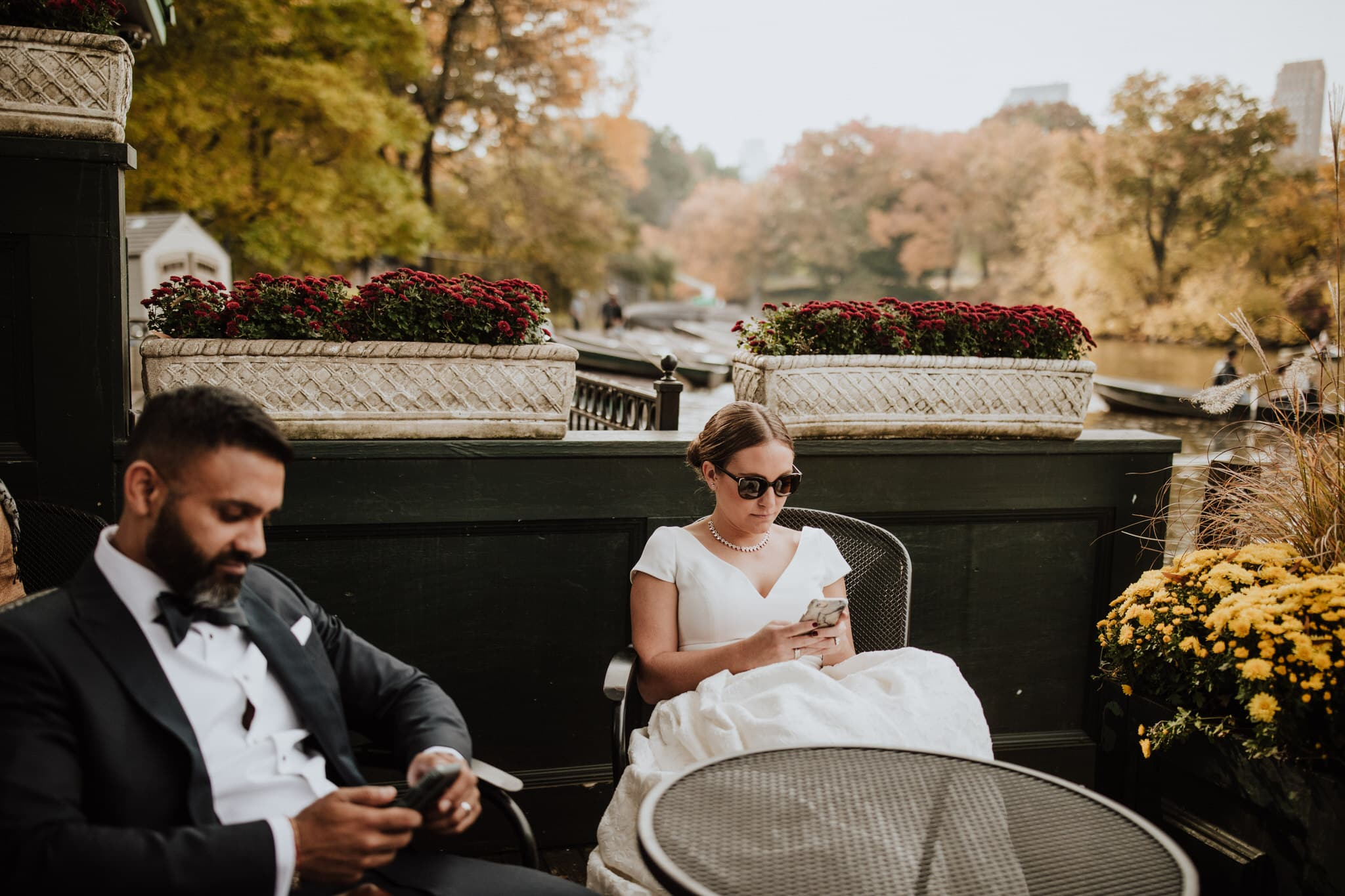 The bride and groom take a break at Tavern on the Green in Central Park, New York City. Wedding Photographer Brent Calis.