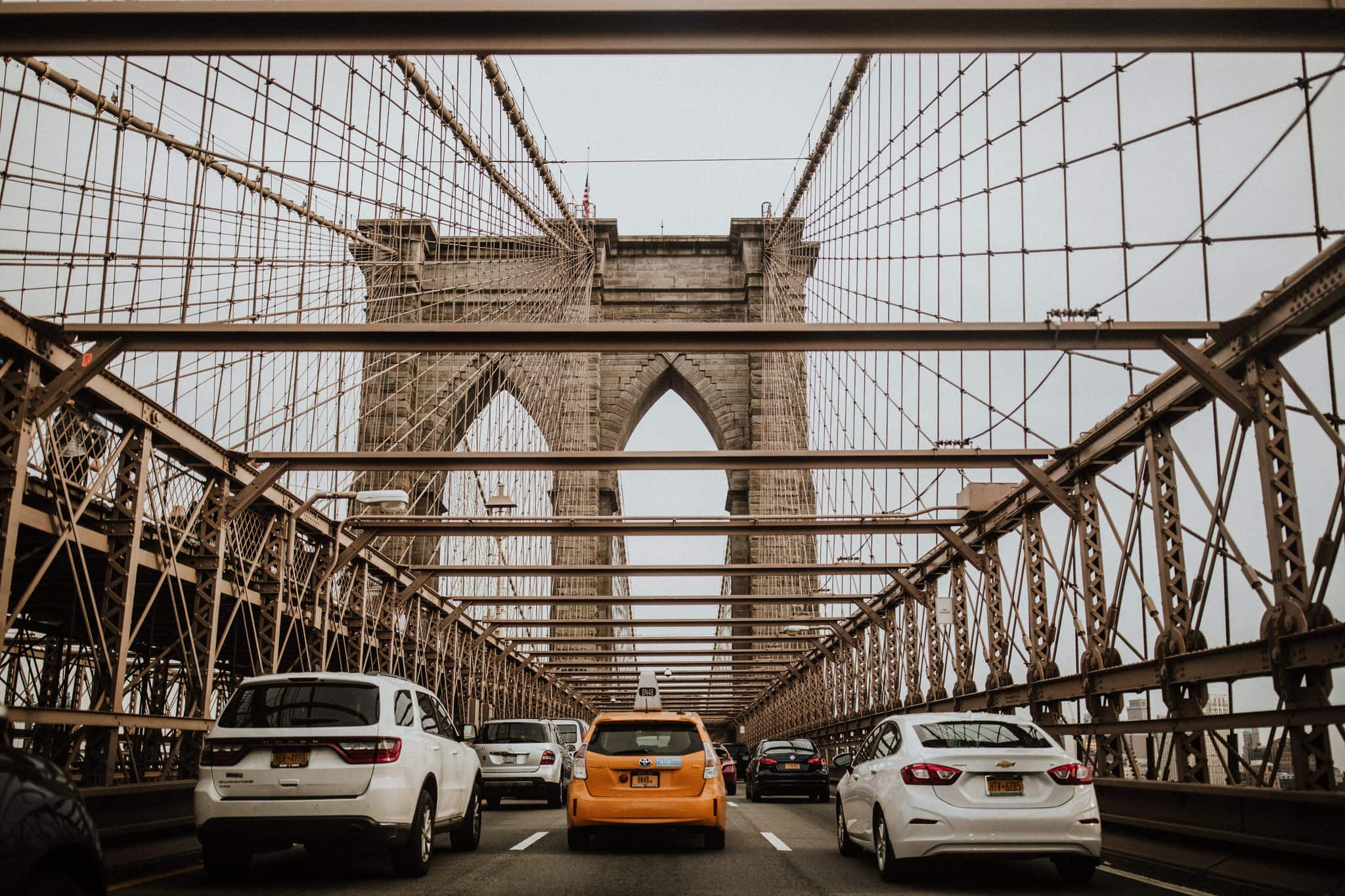 A taxi on the Brooklyn Bridge, New York City. Wedding Photographer Brent Calis.