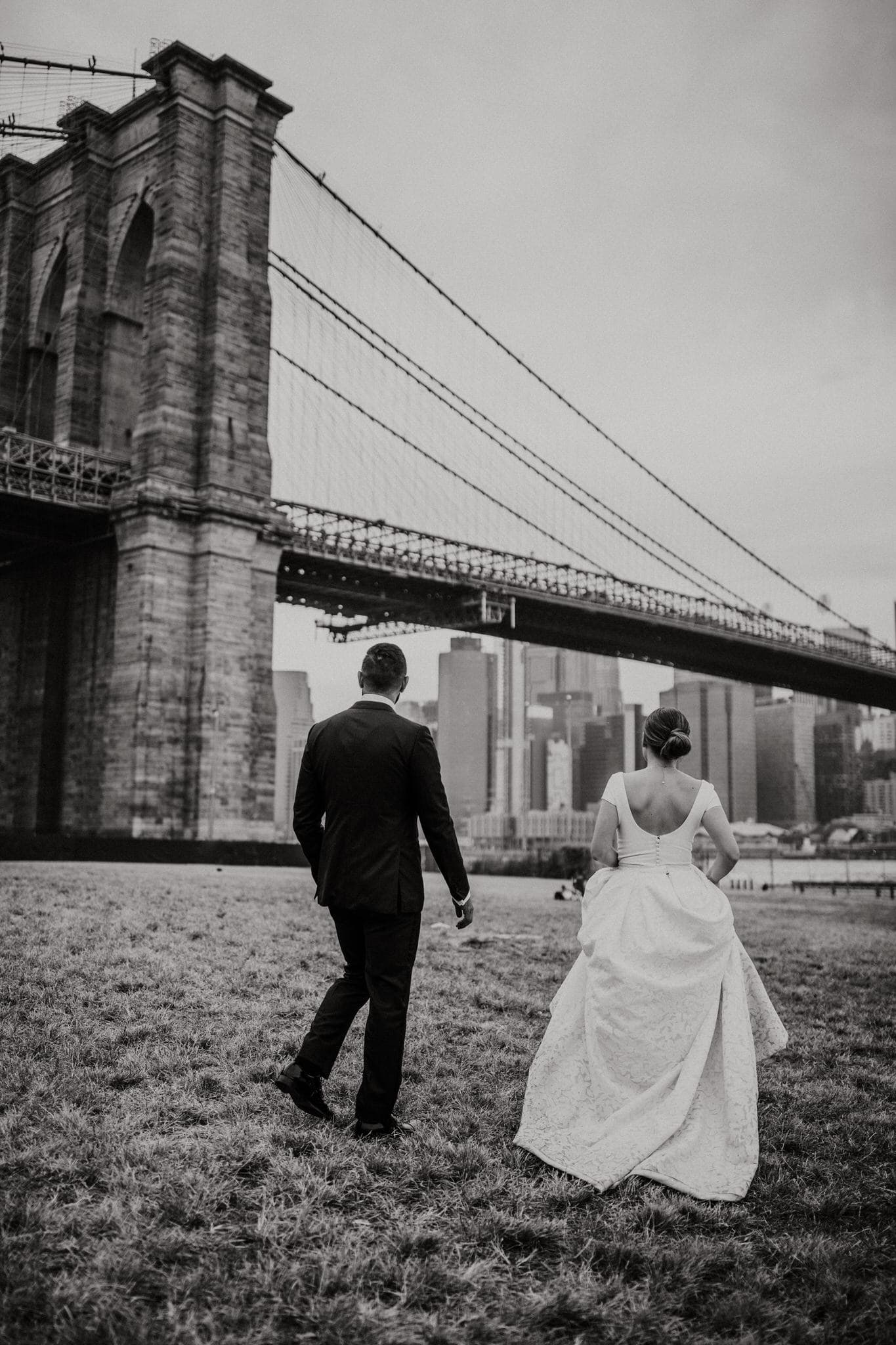 Black and white photo of the bride and groom at Brooklyn Bridge Park, New York. Wedding Photographer Brent Calis.