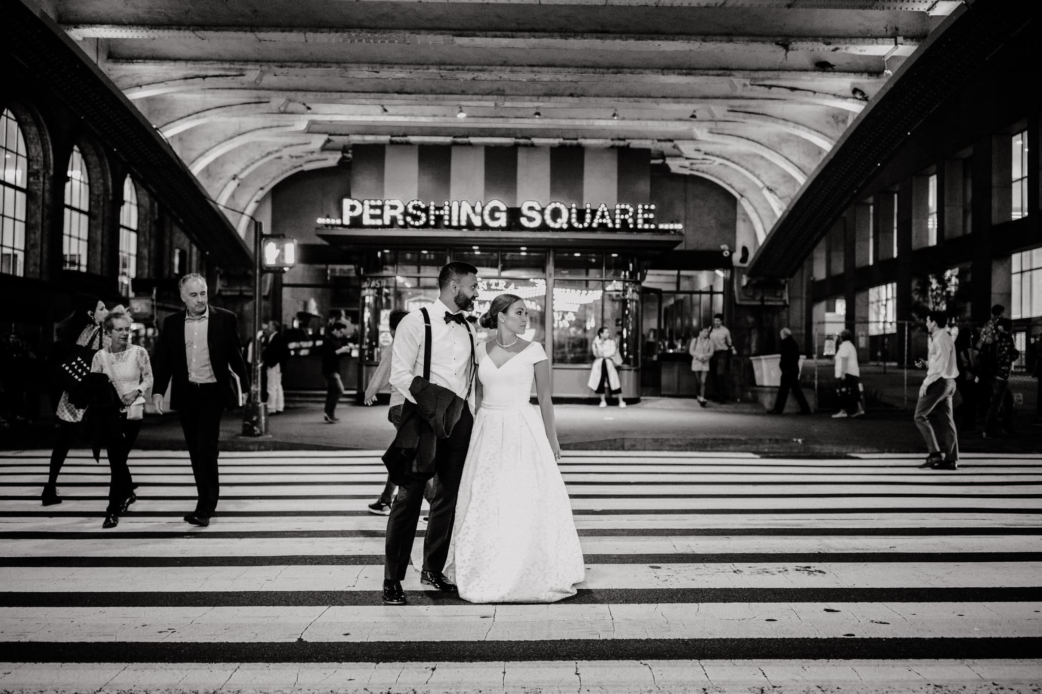 Black and white portrait of the bride and groom at Pershing Square, New York. Wedding Photographer Brent Calis.
