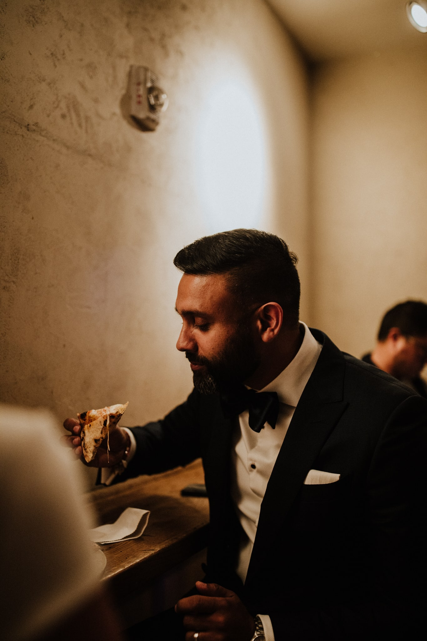The groom at Roberta's Pizza in New York City. Wedding Photographer Brent Calis.