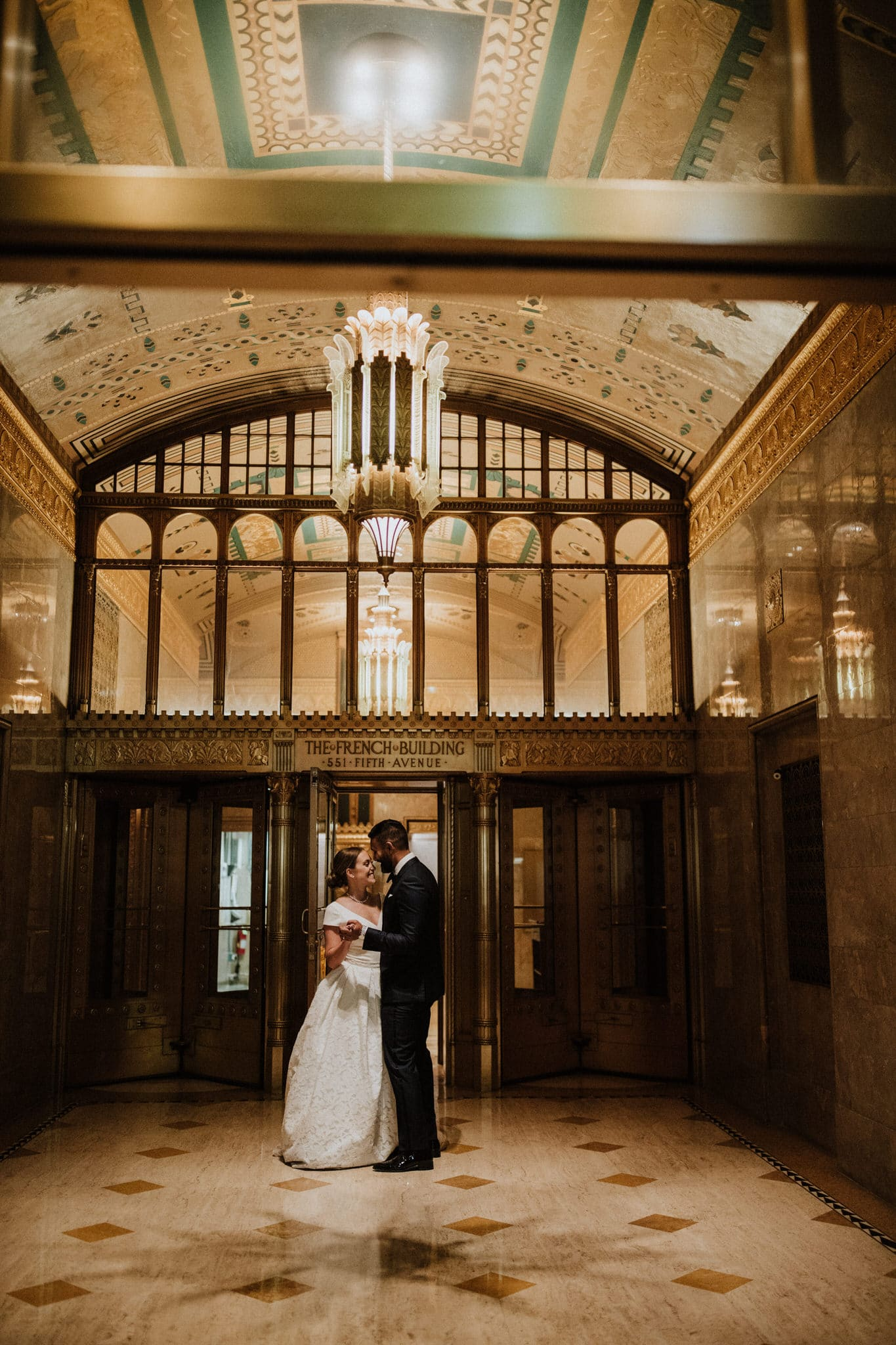 The bride and groom dance in The French Building in New York City. Wedding Photographer Brent Calis.