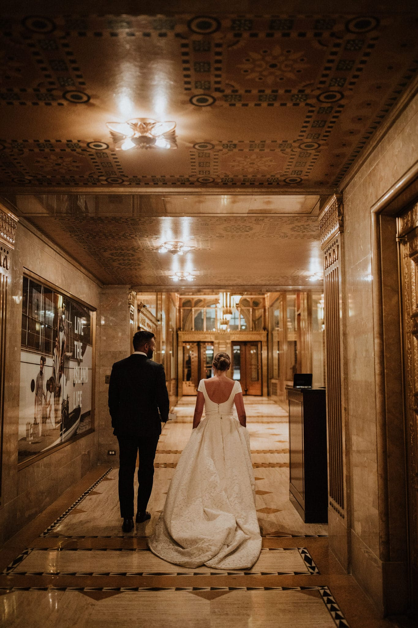 The bride and groom in The French Building in New York City. Wedding Photographer Brent Calis.