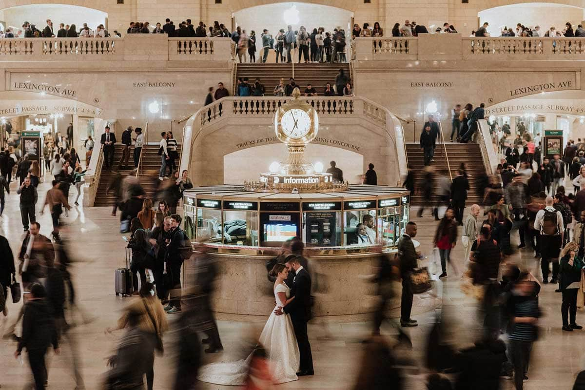 The bride and groom in Grand Central Terminal, New York. Wedding Photographer Brent Calis.
