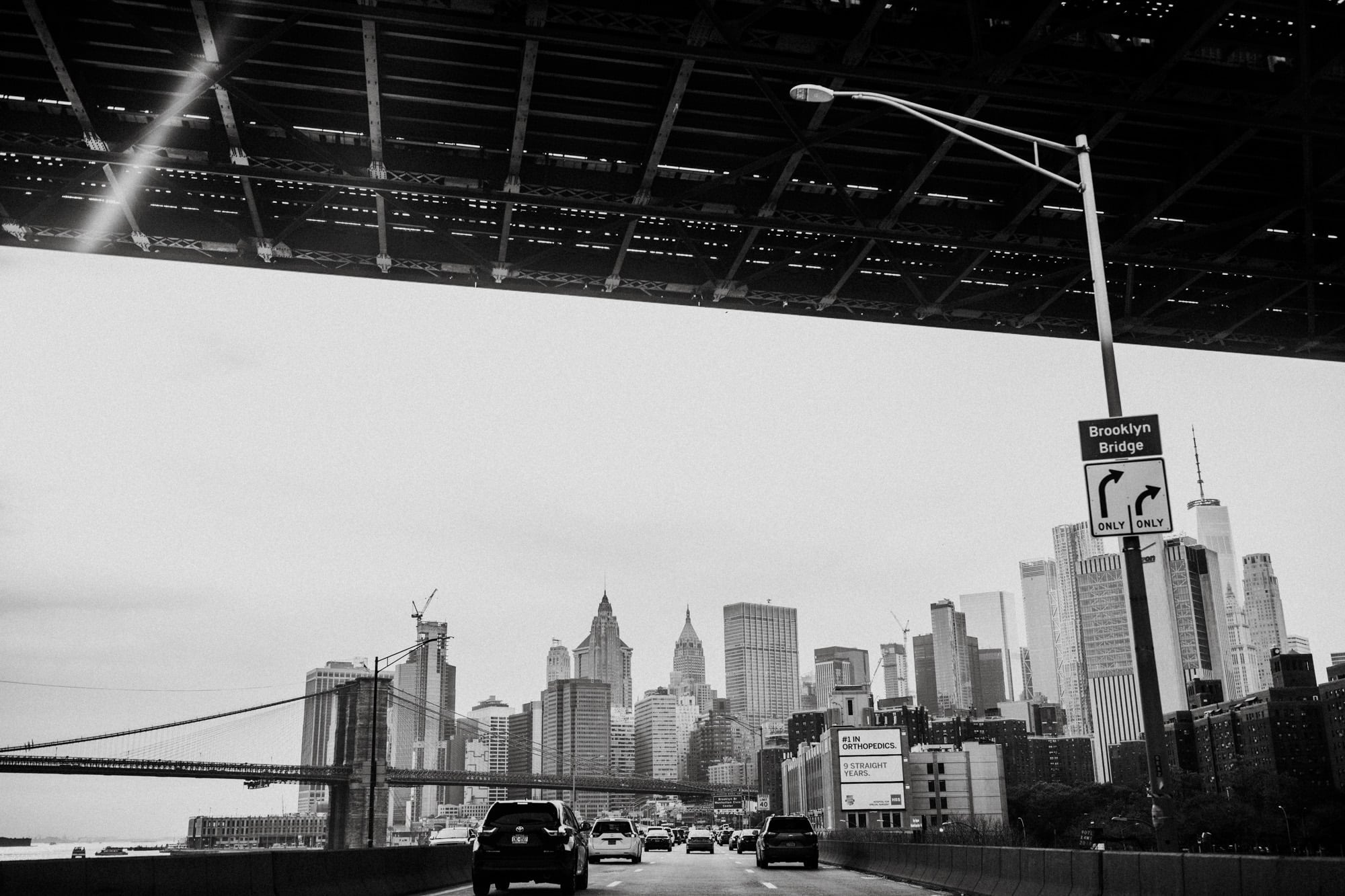 Black and white photo from a taxi ride through New York City. Wedding Photographer Brent Calis.