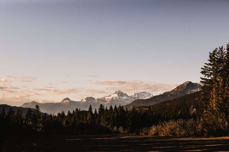Sunrise over the mountains. Forest wedding mountains of Whistler. Destination wedding photographer Brent Calis.