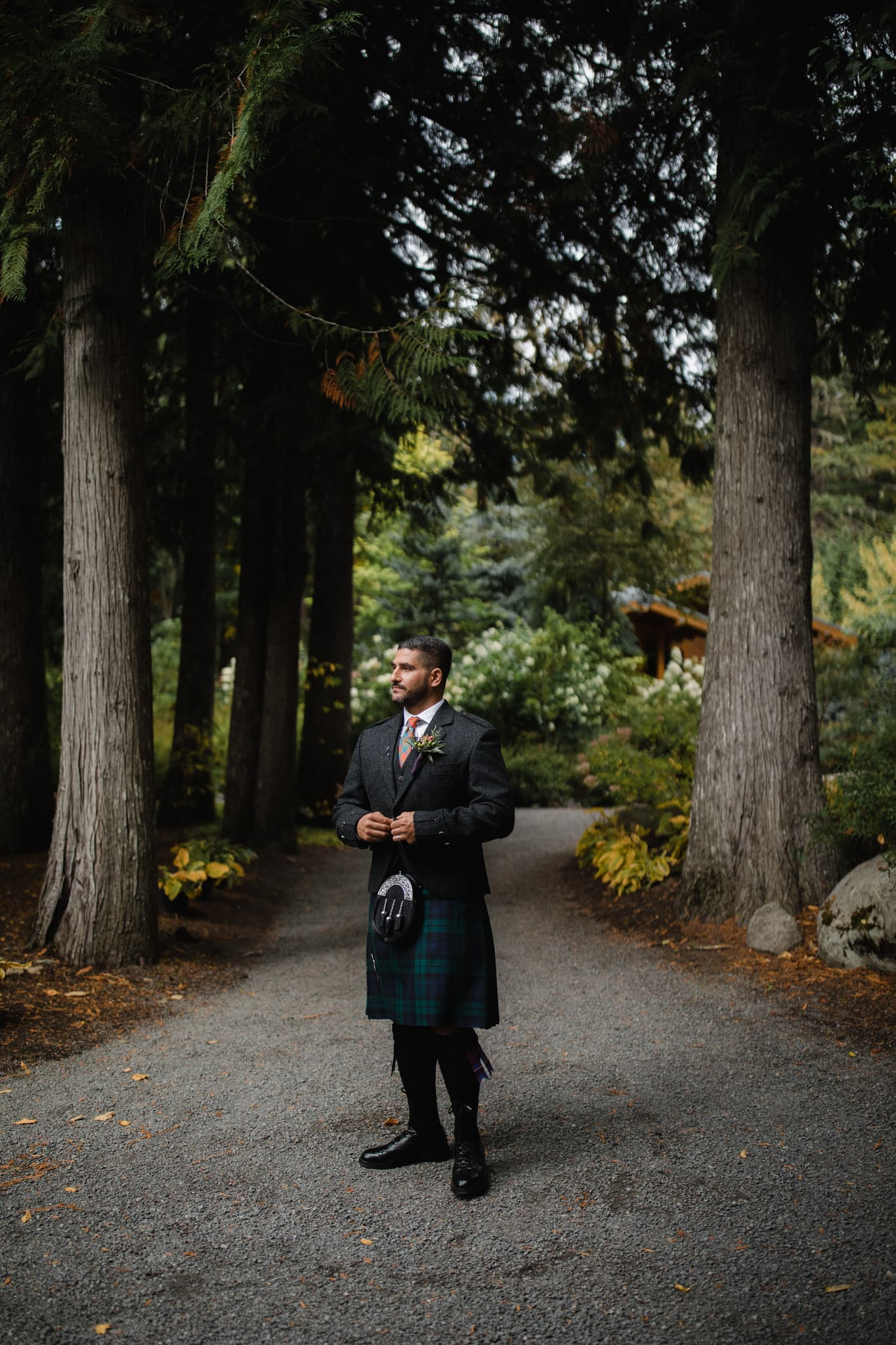 Groom in kilt before forest wedding in mountains of Whistler. Destination wedding photographer Brent Calis.