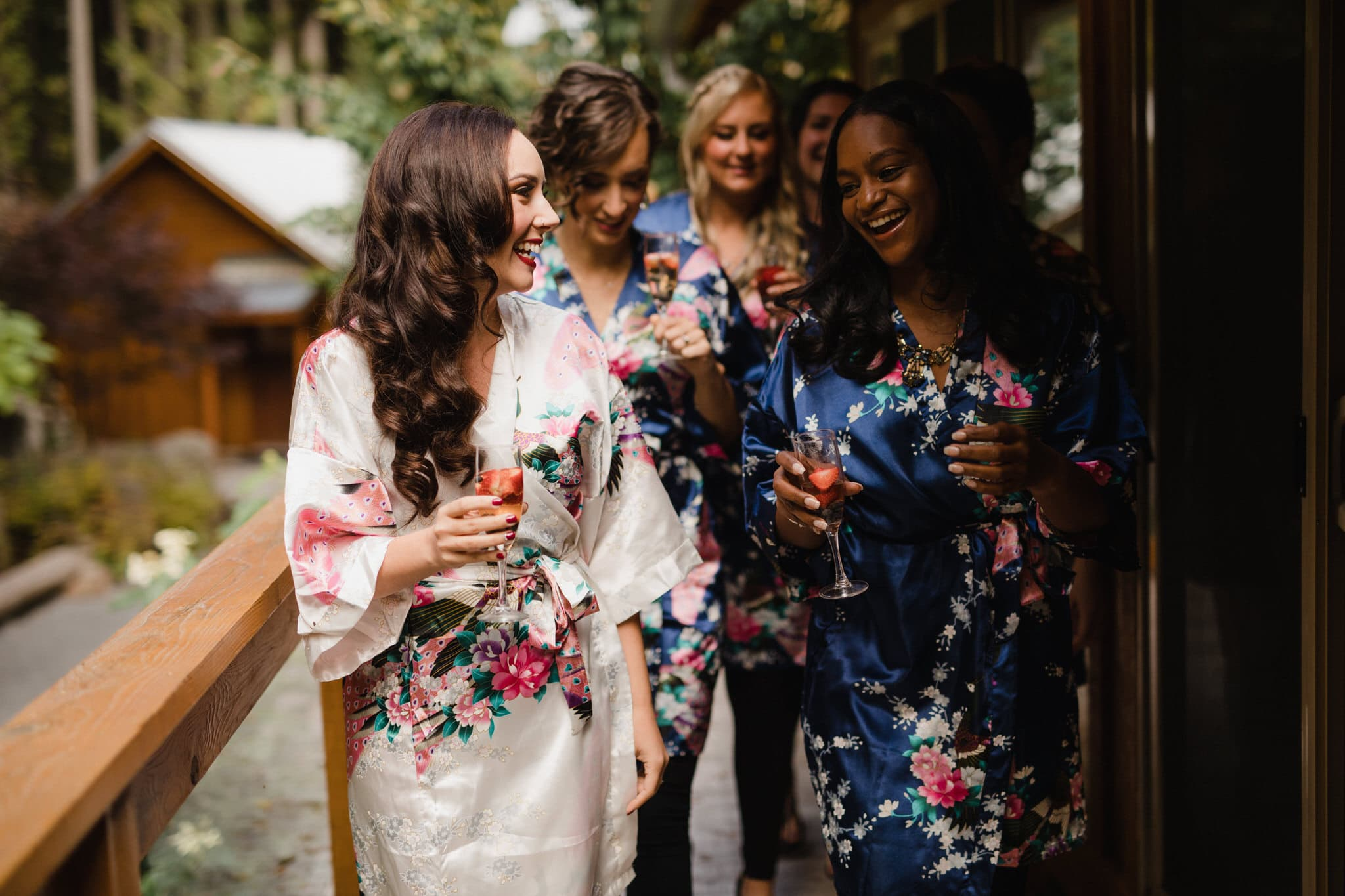 Bridal party in kimonos with champagne before forest wedding at The Brew Creek Centre in Whistler. Destination wedding photographer Brent Calis.