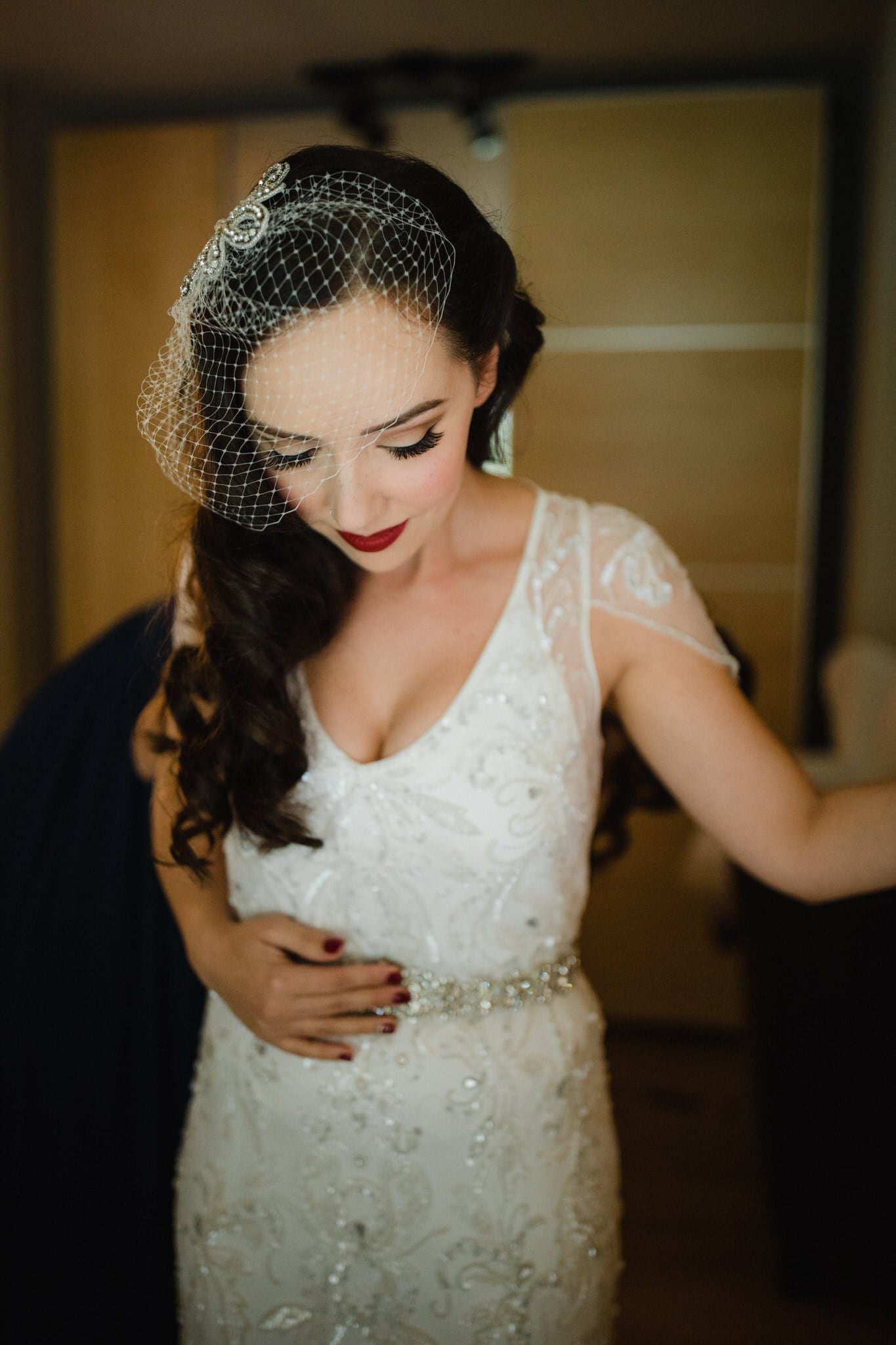 Bride getting ready with vintage veil. Destination wedding photographer Brent Calis.