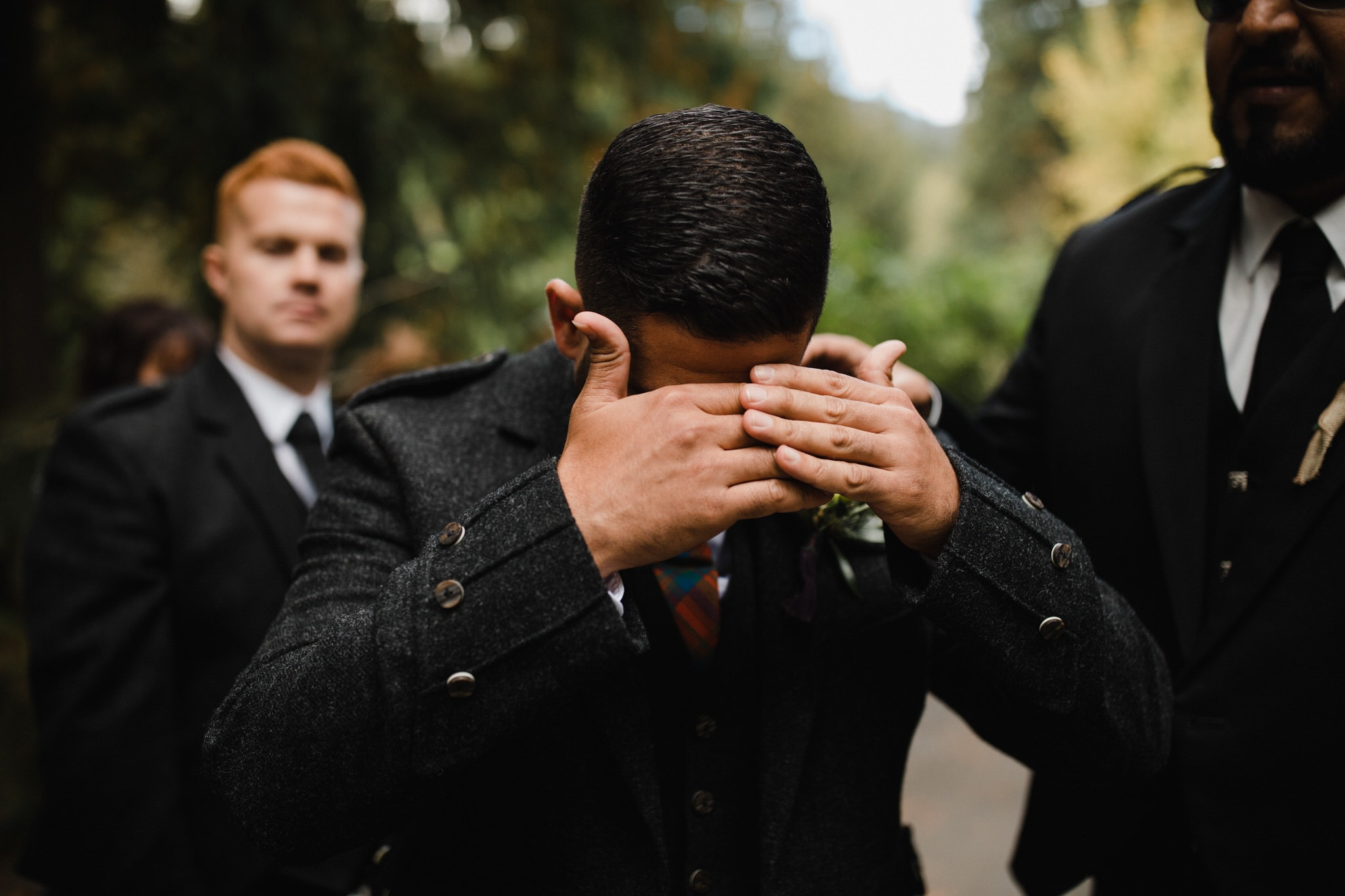 Groom hides his eyes before first look. Destination wedding photographer Brent Calis.
