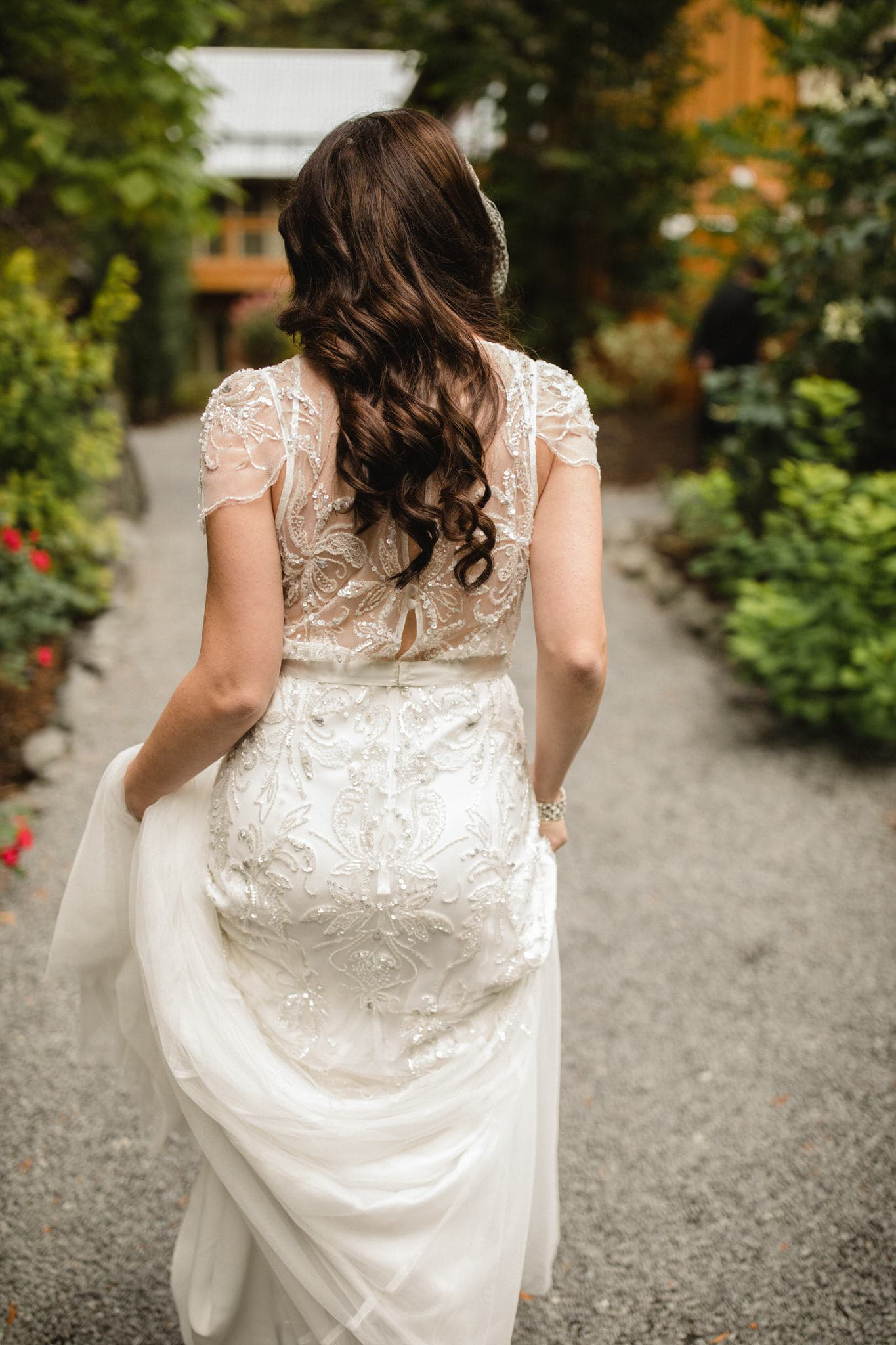 Bride walks to first look at The Brew Creek Centre in Whistler. Destination wedding photographer Brent Calis.