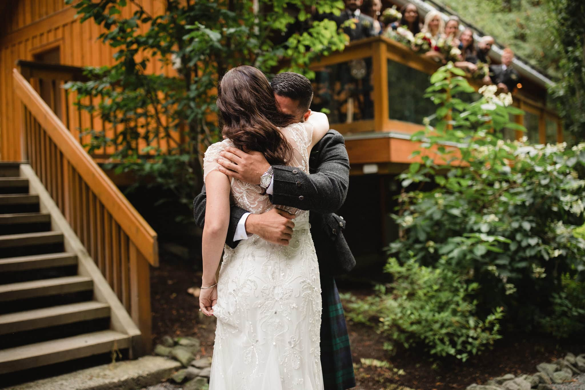 Bride and groom hug after first look at The Brew Creek Centre in Whistler. Destination wedding photographer Brent Calis.