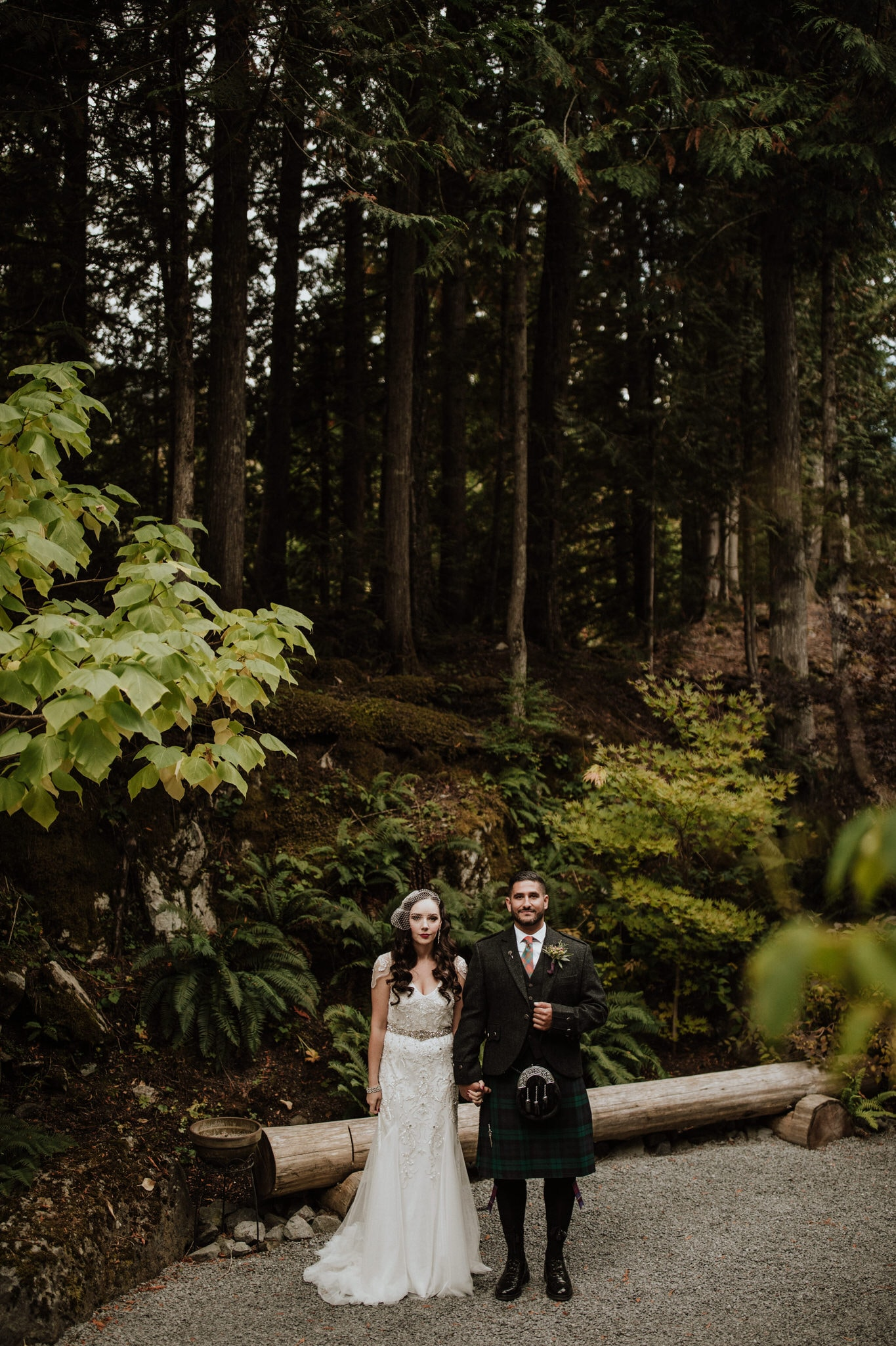 Bride and groom pose in the forest in the moutinas of Whistler. Destination wedding photographer Brent Calis.