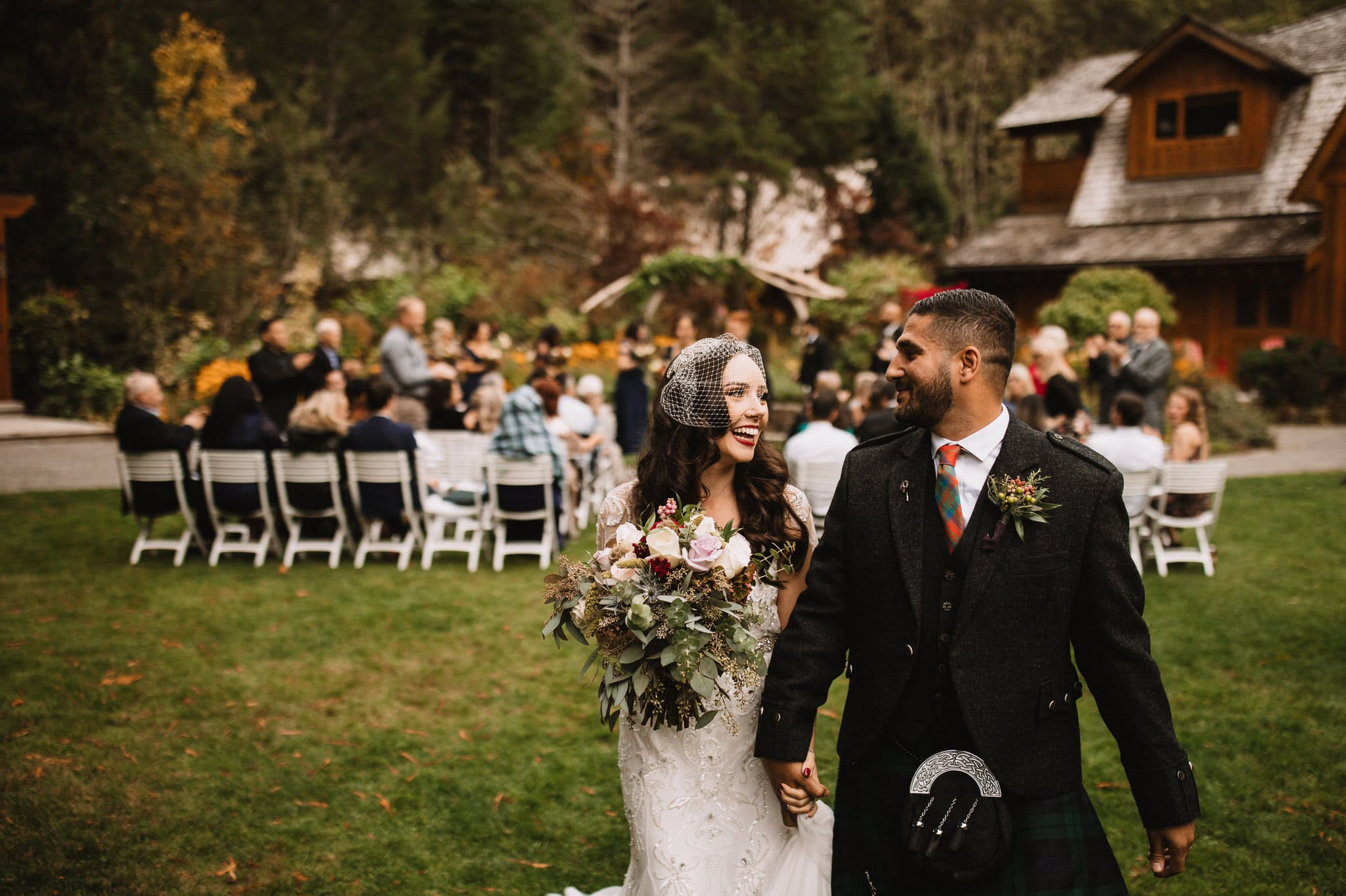 Bride and groom laughing at their Brew Creek Centre wedding in Whistler. Destination wedding photographer Brent Calis.