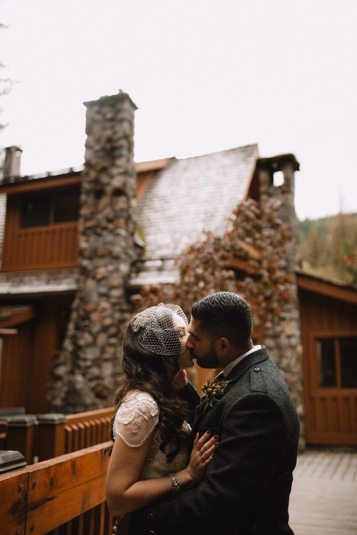Bride and groom kiss at The Brew Creek Centre in Whistler. Destination wedding photographer Brent Calis.