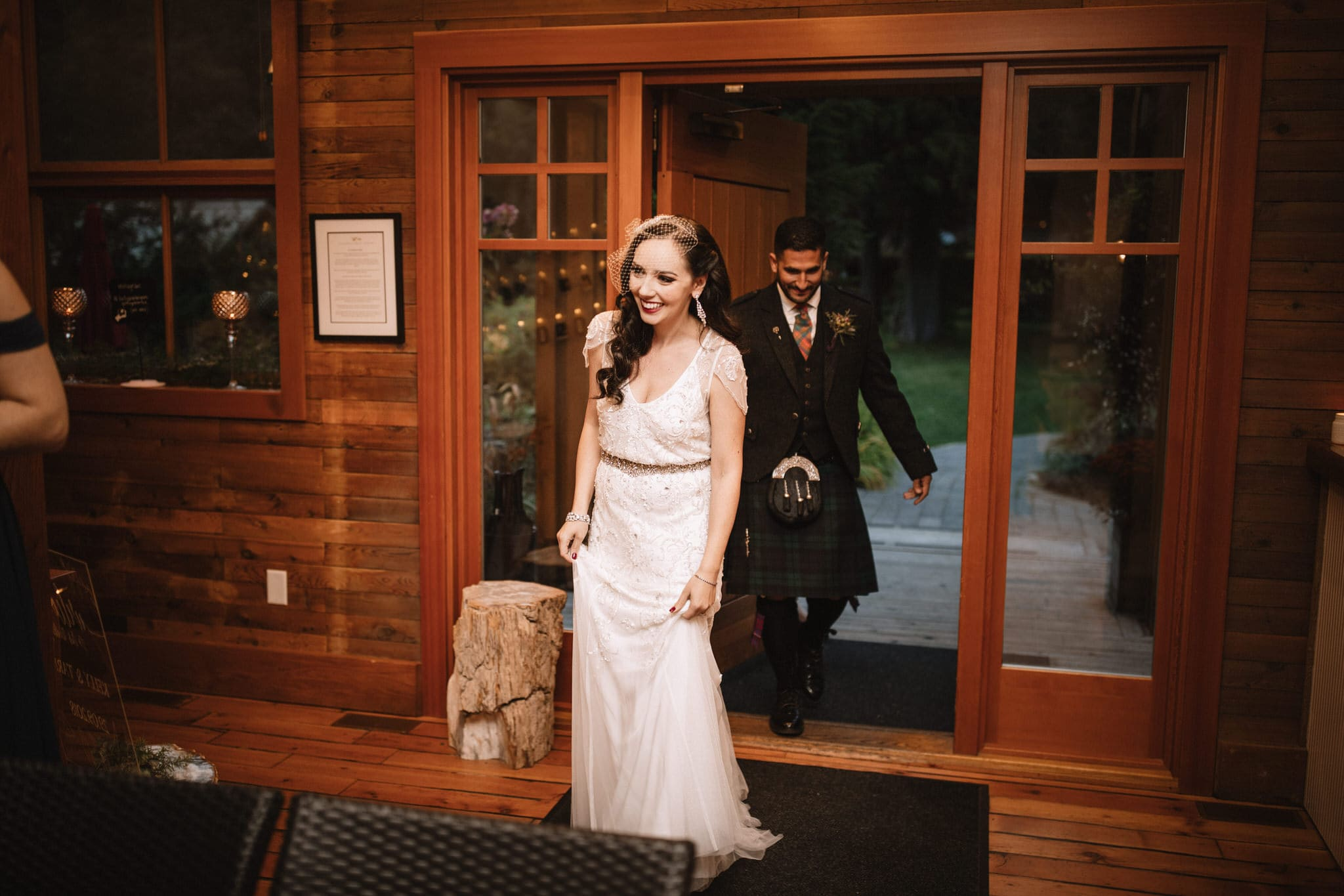 Bride and groom arrive to the wedding reception at Brew Creek Centre Whistler. Destination wedding photographer Brent Calis.