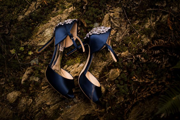 Blue Badgley Mishka wedding shoes on moss in the forests of Whistler Mountain. Destination wedding photographer Brent Calis.