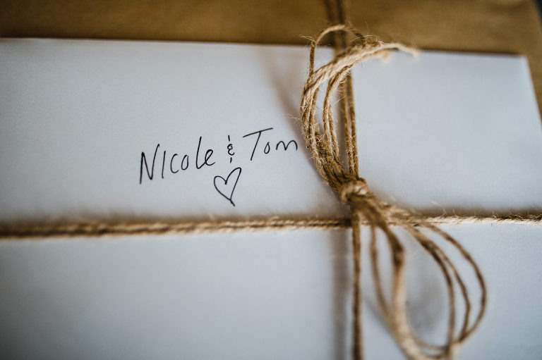 Wedding gift wrapped with twine. Destination wedding photographer Brent Calis.