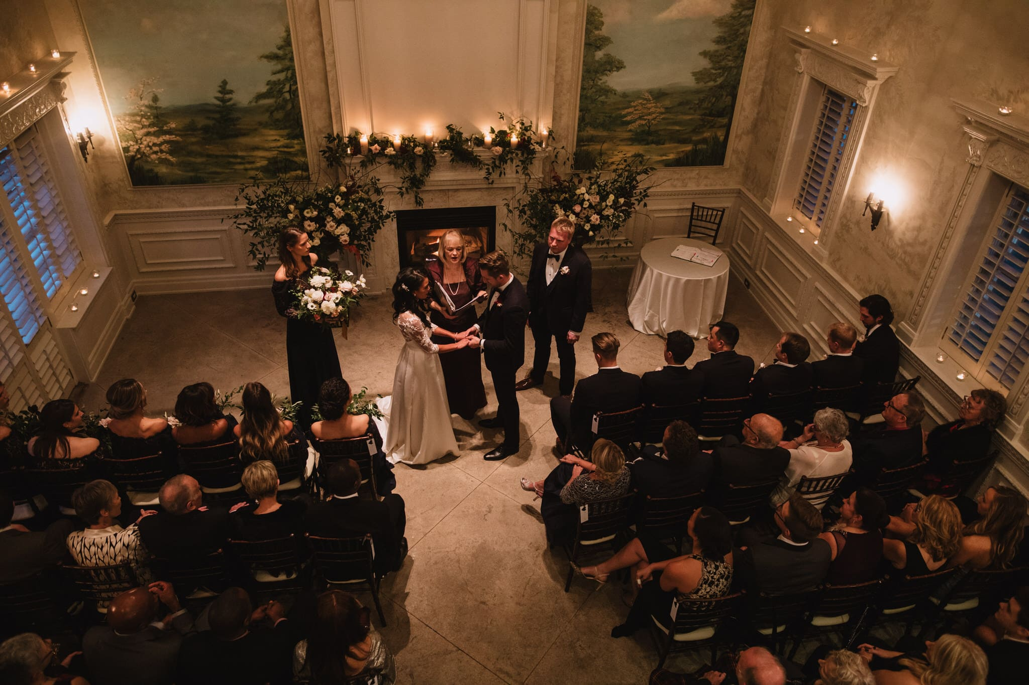 Bride and groom stand at the alter at Graydon Hall Manor wedding in Toronto