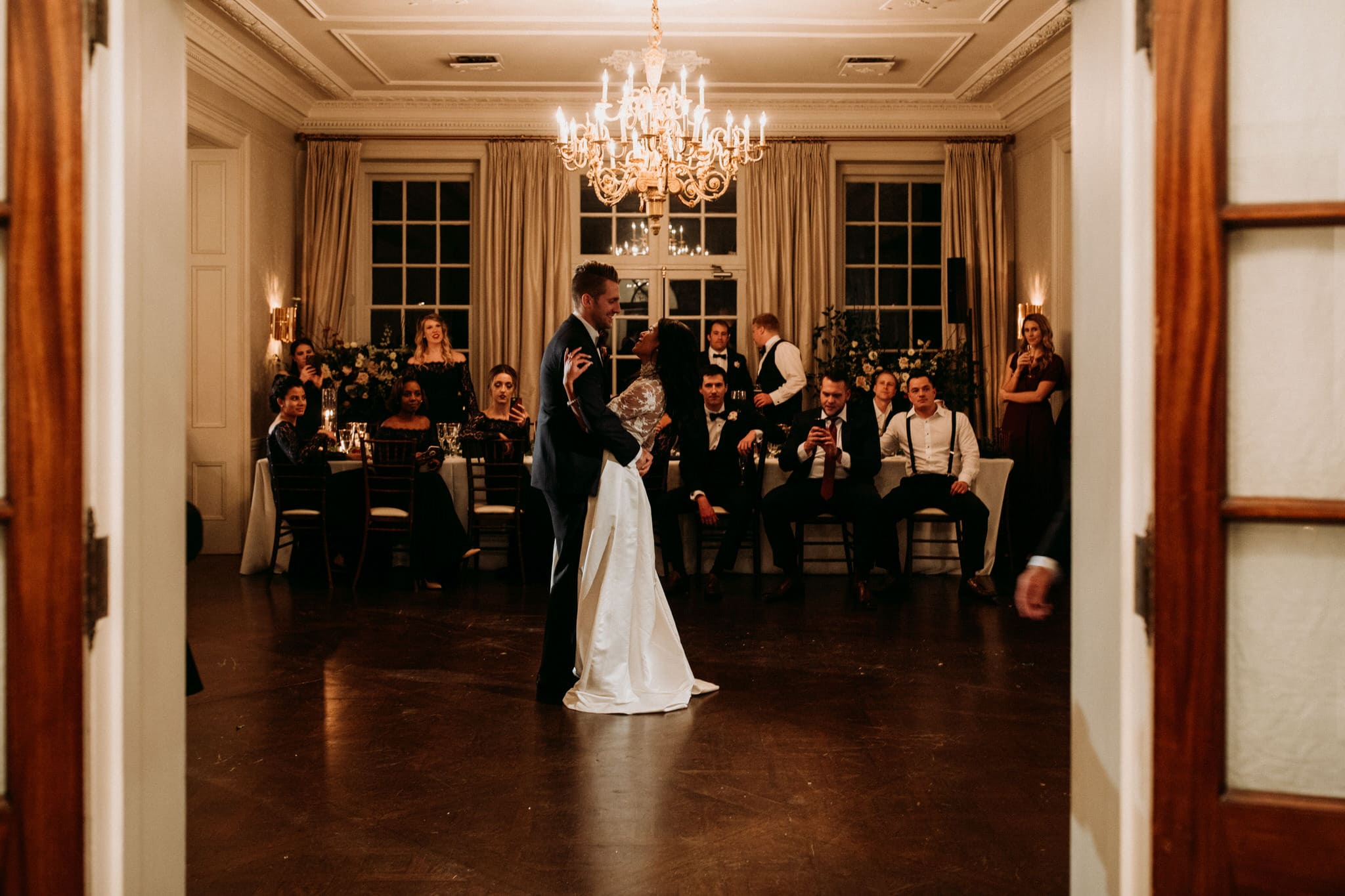 First dance under candelabra at Graydon Hall Manor Wedding in Toronto