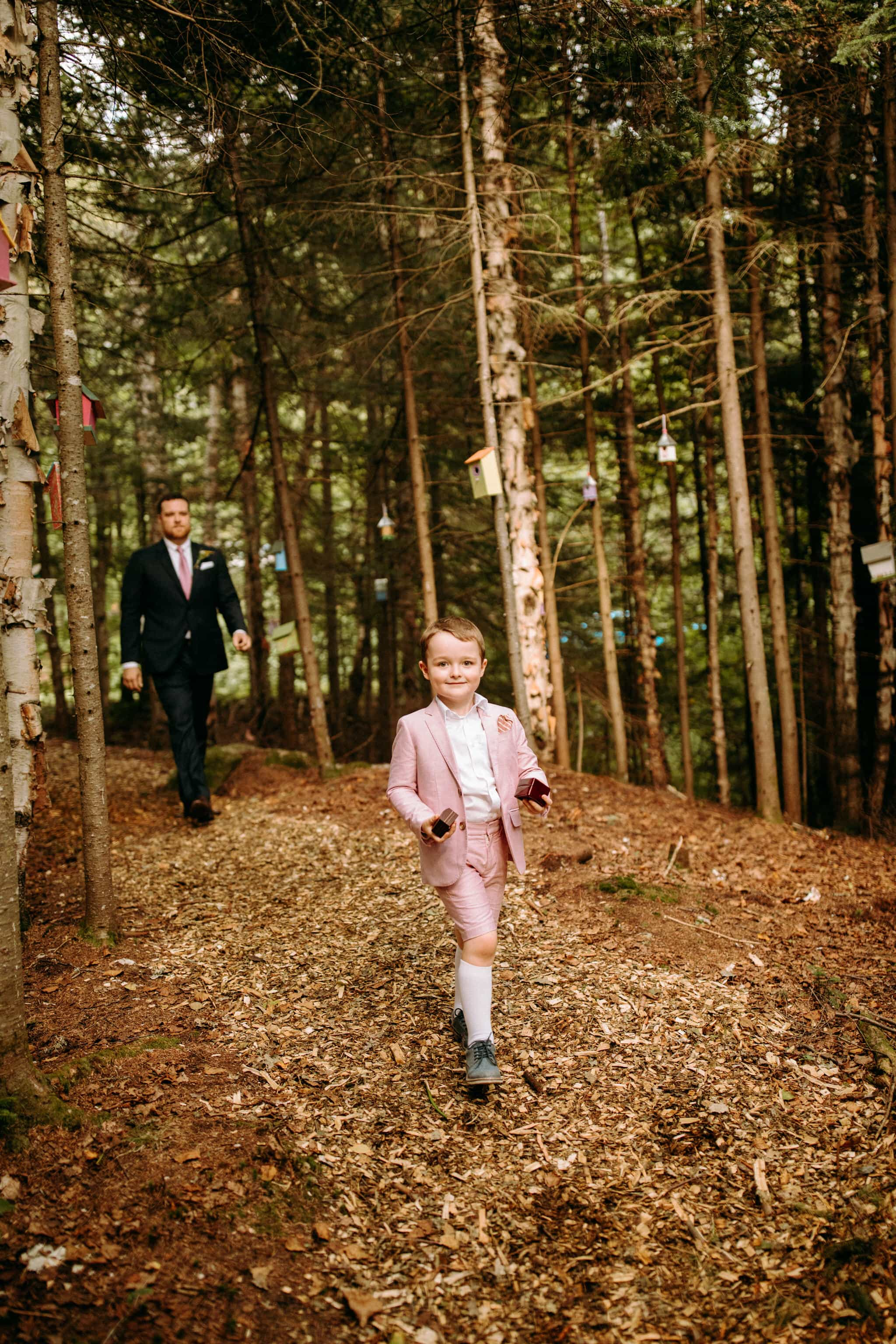 Intimate Wedding in Ivry-sur-le-Lac - Ring bearer in the forest - Wedding Photographer Brent Calis