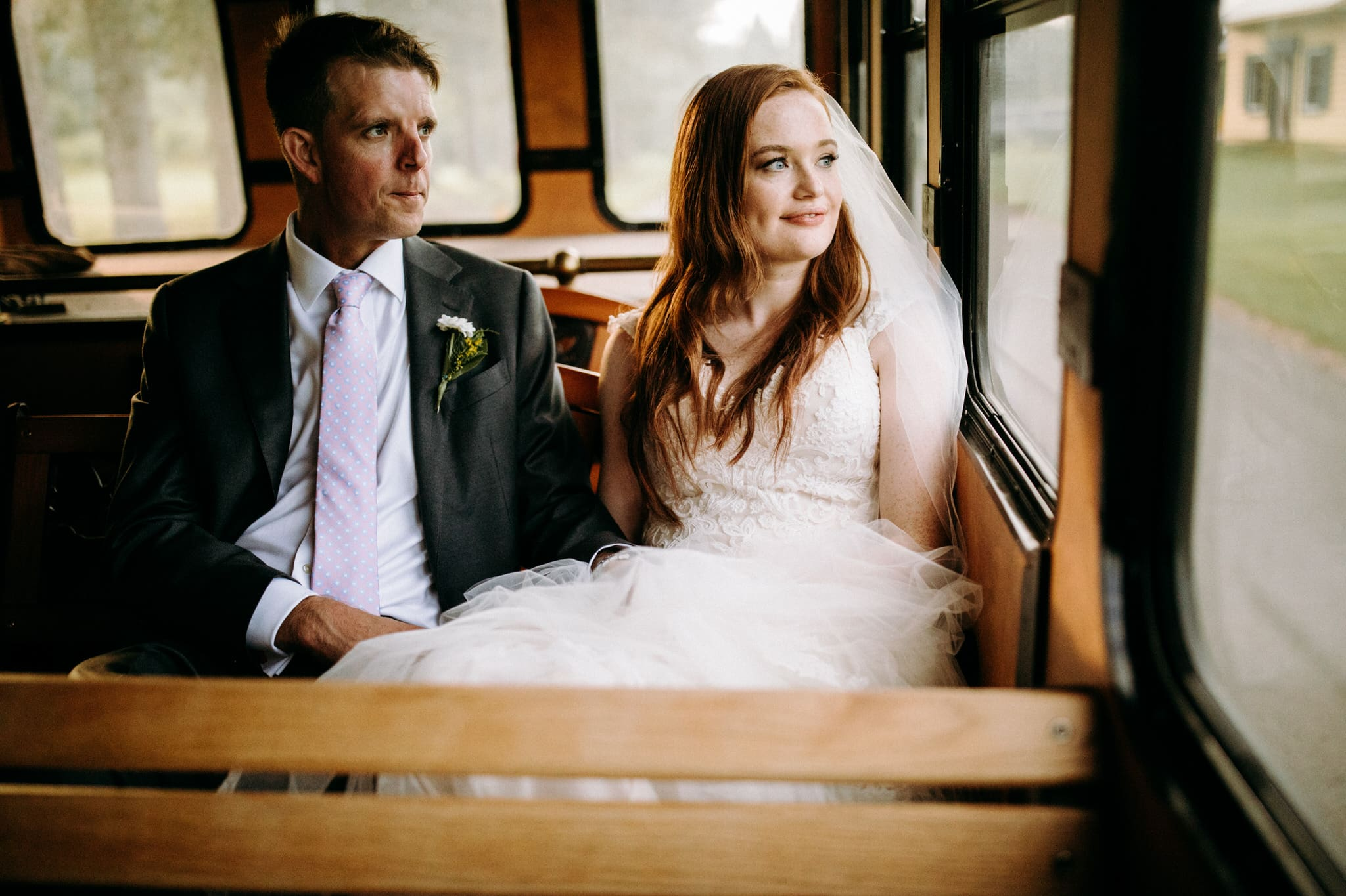 Restaurant wedding at Maison 1890 - Bride and Groom in trolley car - Wedding Photographer Brent Calis