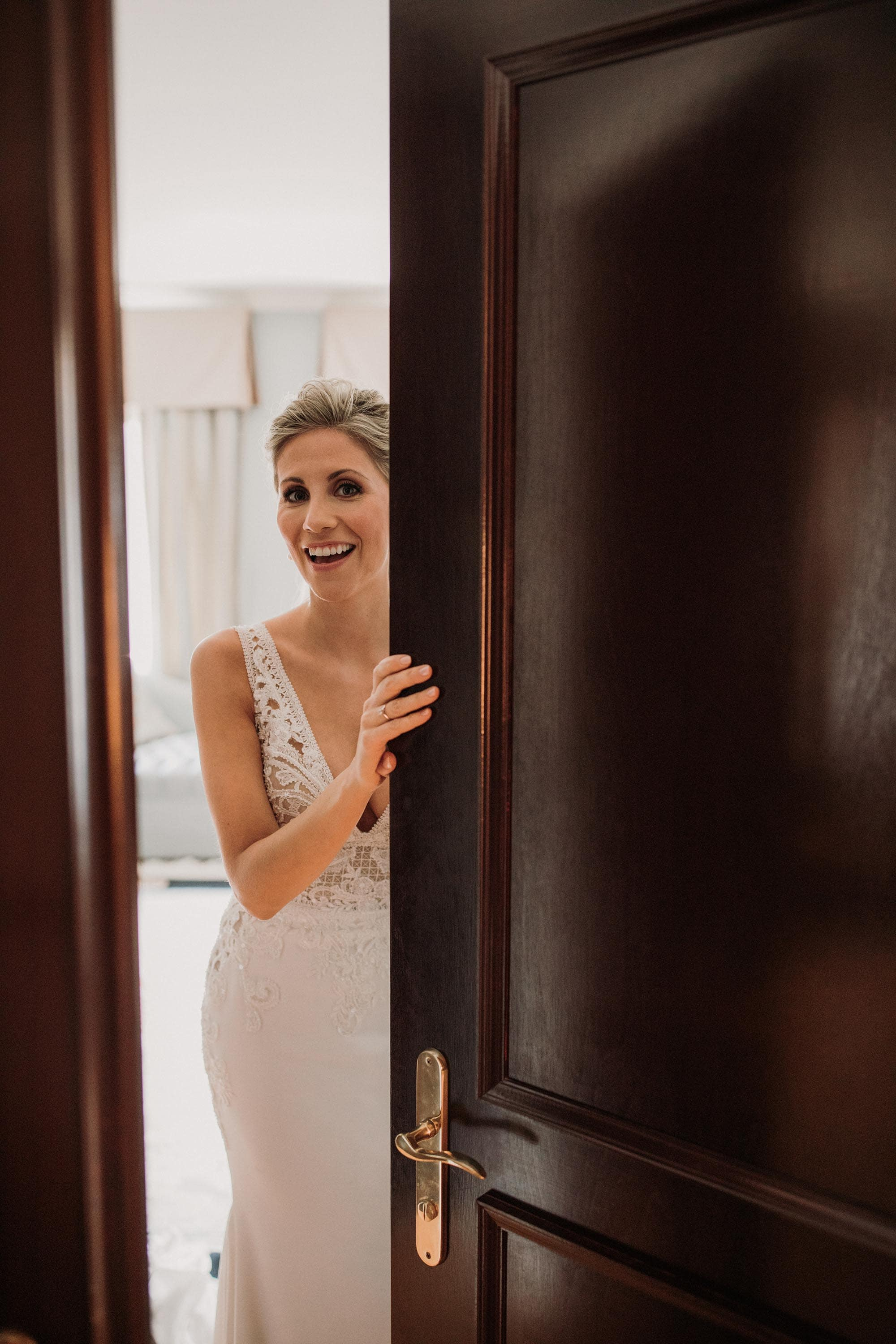 Entrepots Dominion Wedding In Montreal - Bride in doorway - Wedding Photographer Brent Calis