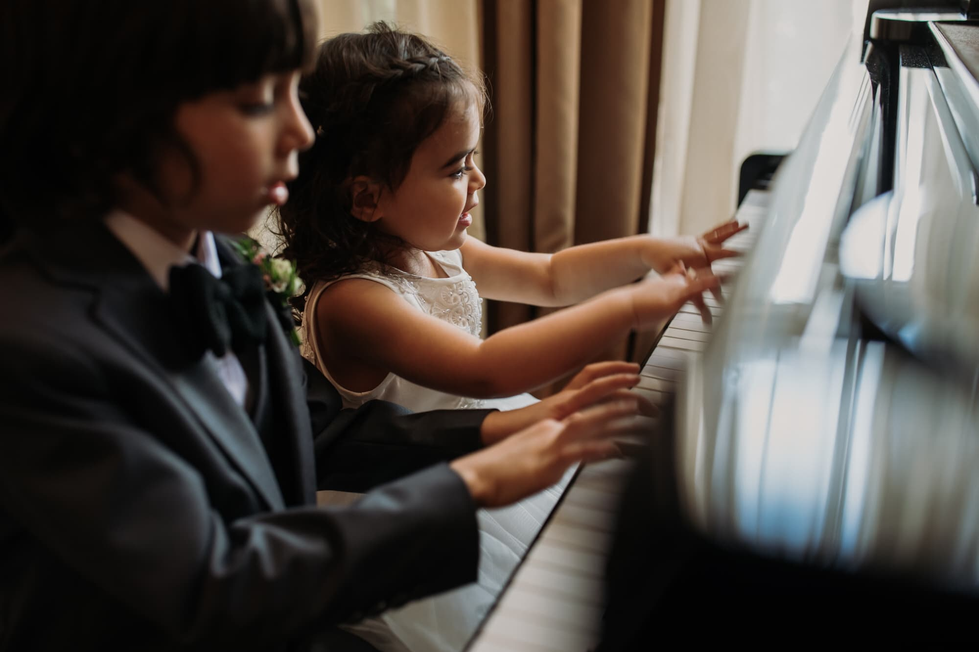 Entrepots Dominion Wedding In Montreal - Children playing piano - Wedding Photographer Brent Calis