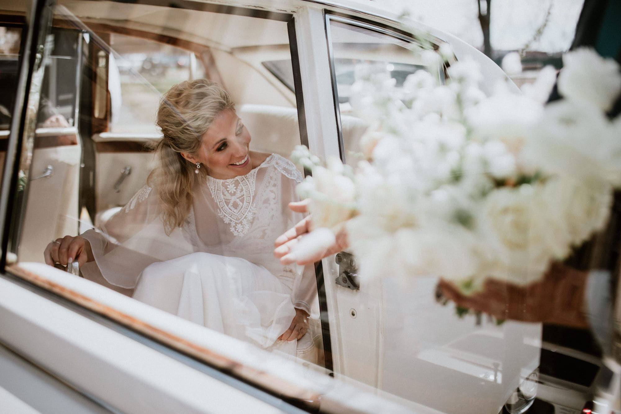 Entrepots Dominion Wedding In Montreal - Bride stepping out of car - Wedding Photographer Brent Calis