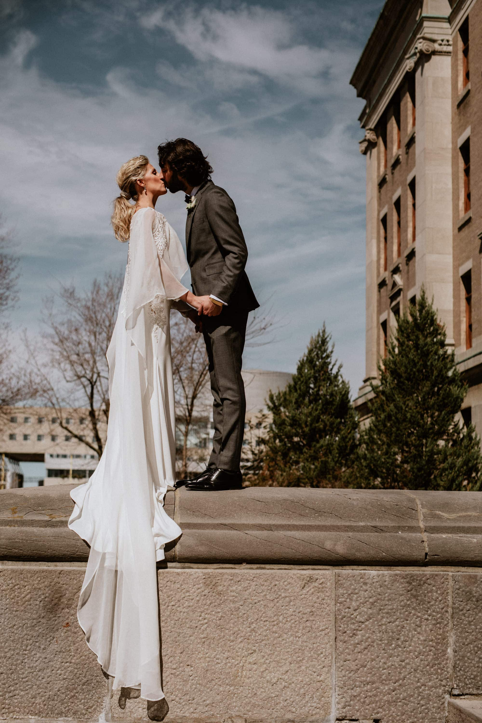 Entrepots Dominion Wedding In Montreal - Epic kiss outside of church - Wedding Photographer Brent Calis